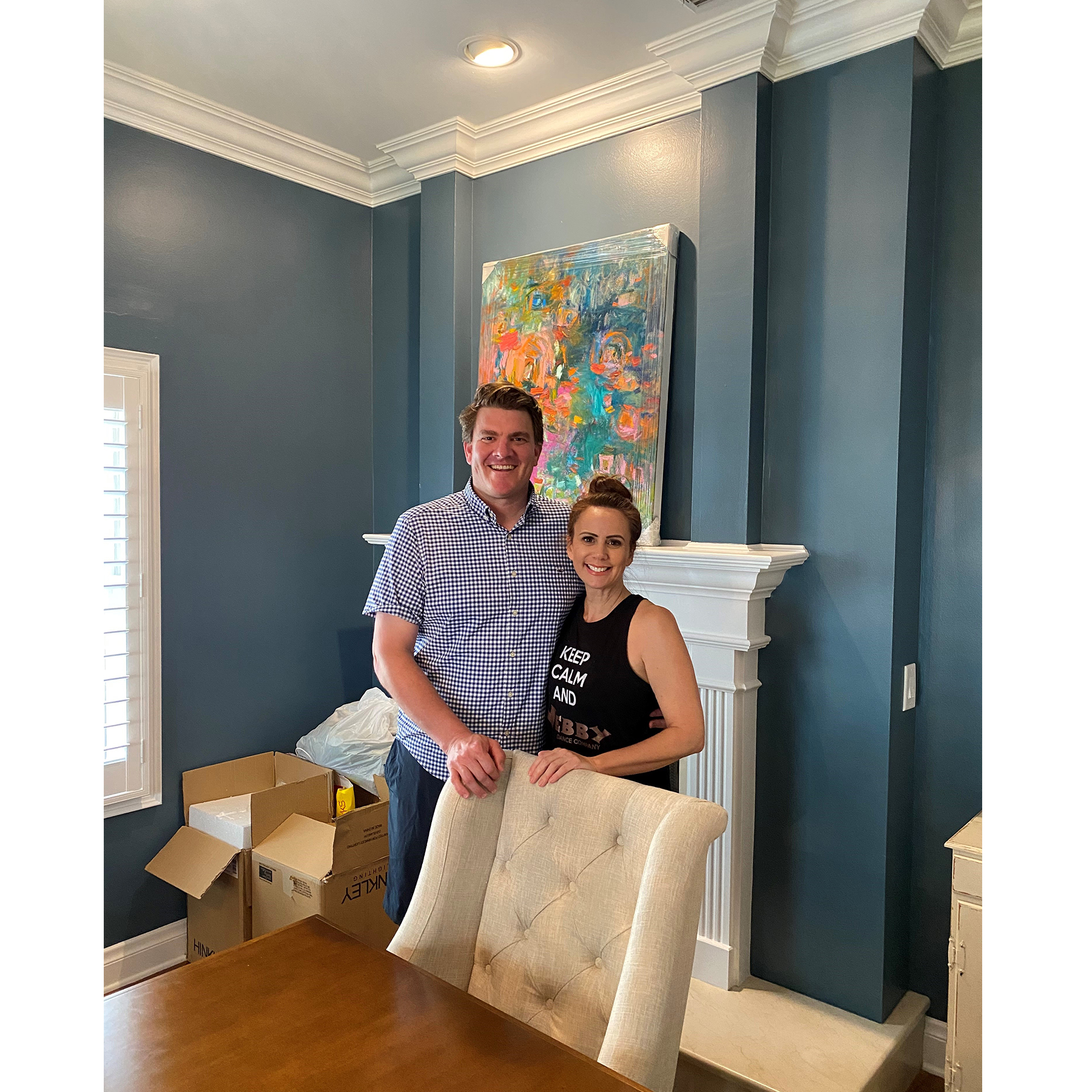 Clients in front of an abstract painting in their home