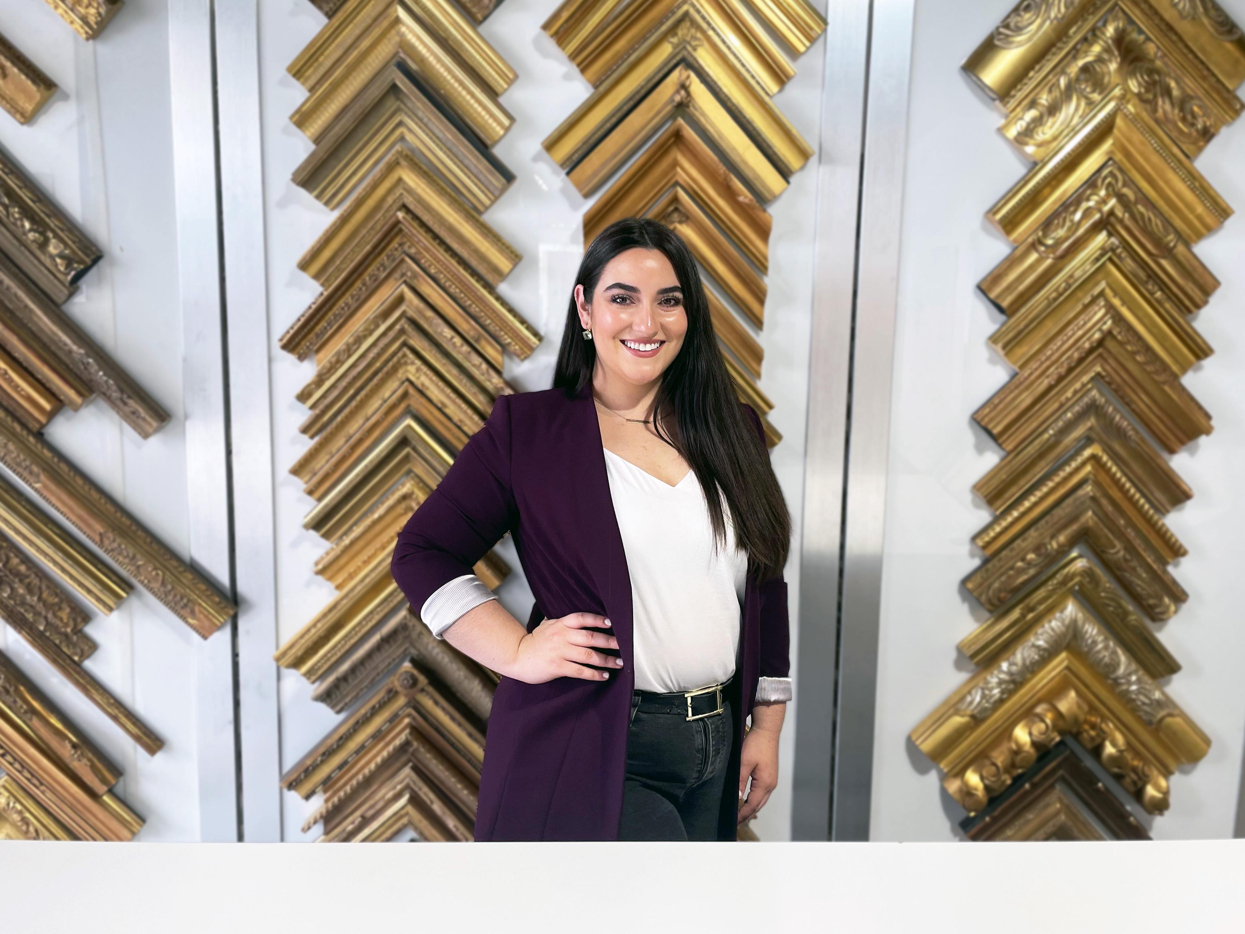 Framing Assistant Isabella Guisasola in front of frame samples