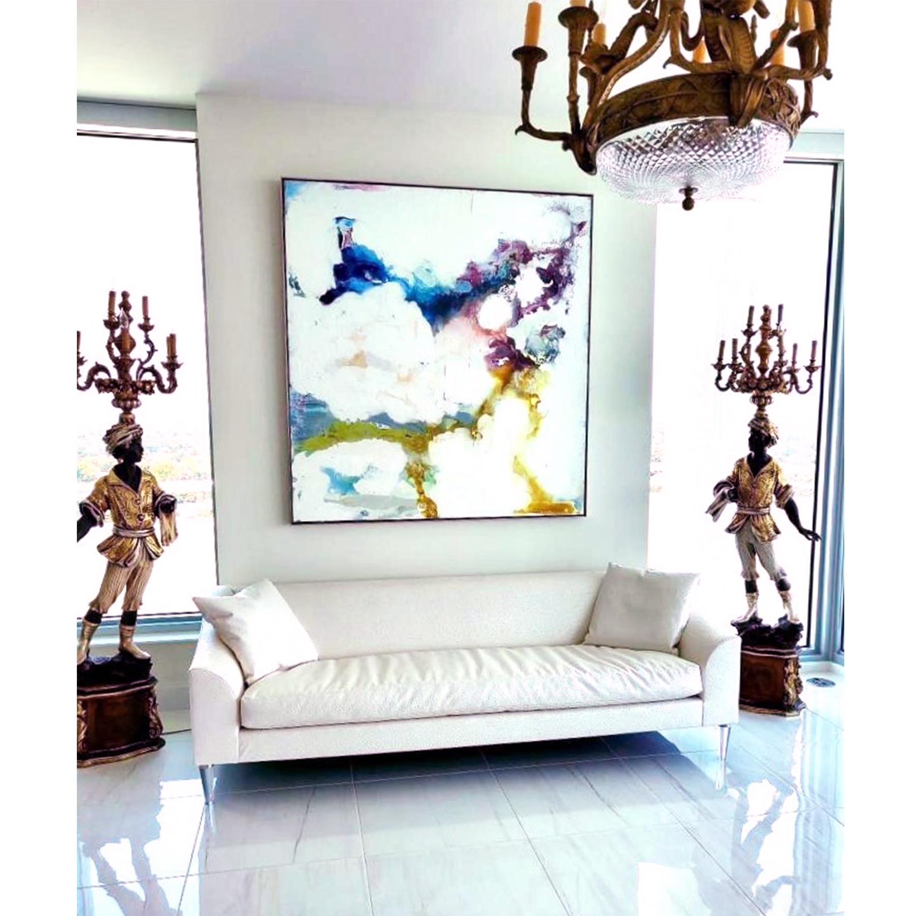 Framed abstract painting installed in a living room