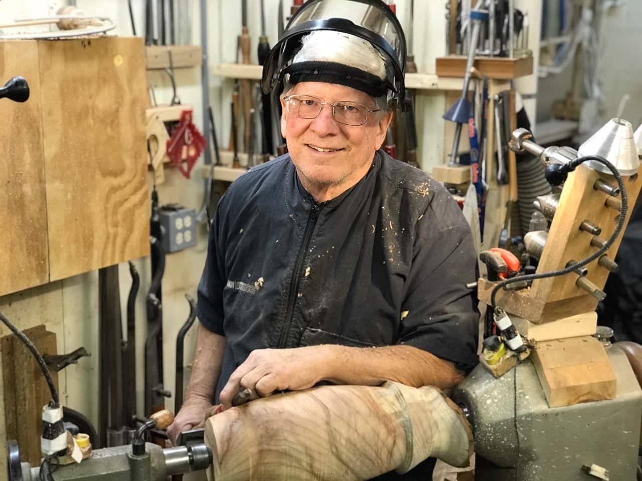 John Williams preparing for art showcase on his woodturning lathe.