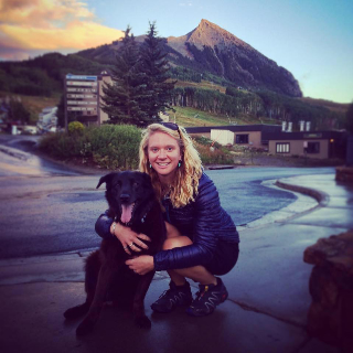 Jenny Fitzgerald, Employee Of Gallery Wild In Downtown Jackson Hole, Poses With Her Dog