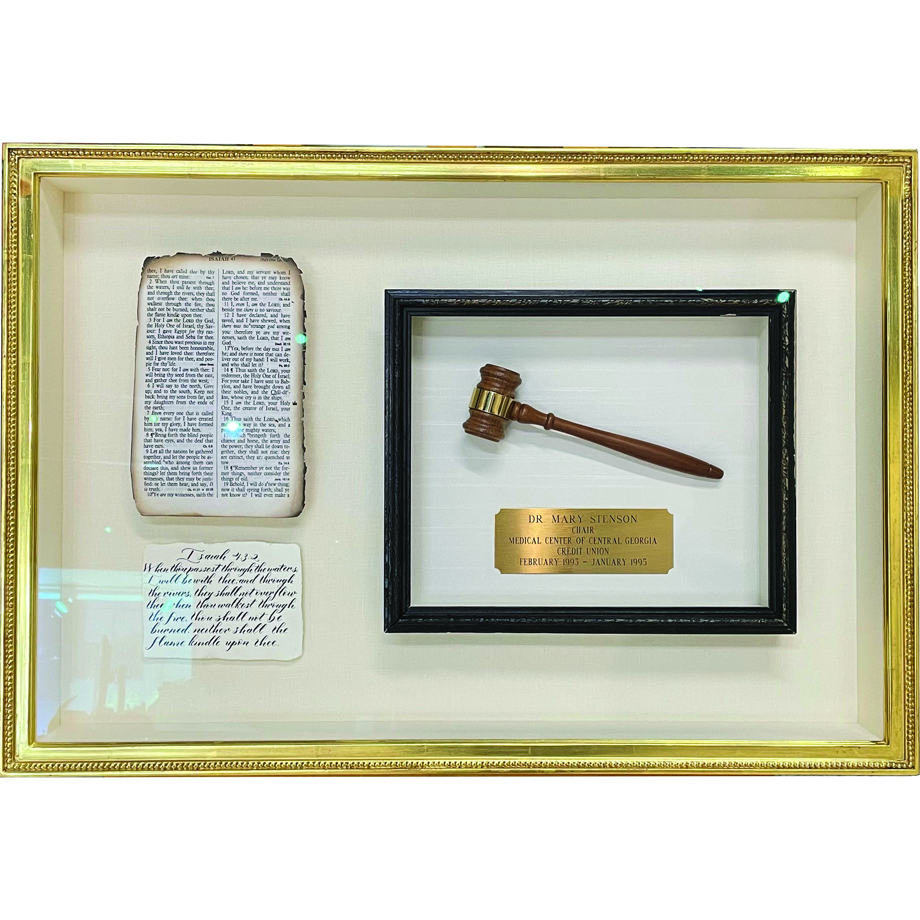 Gavel and papers in a gold custom frame