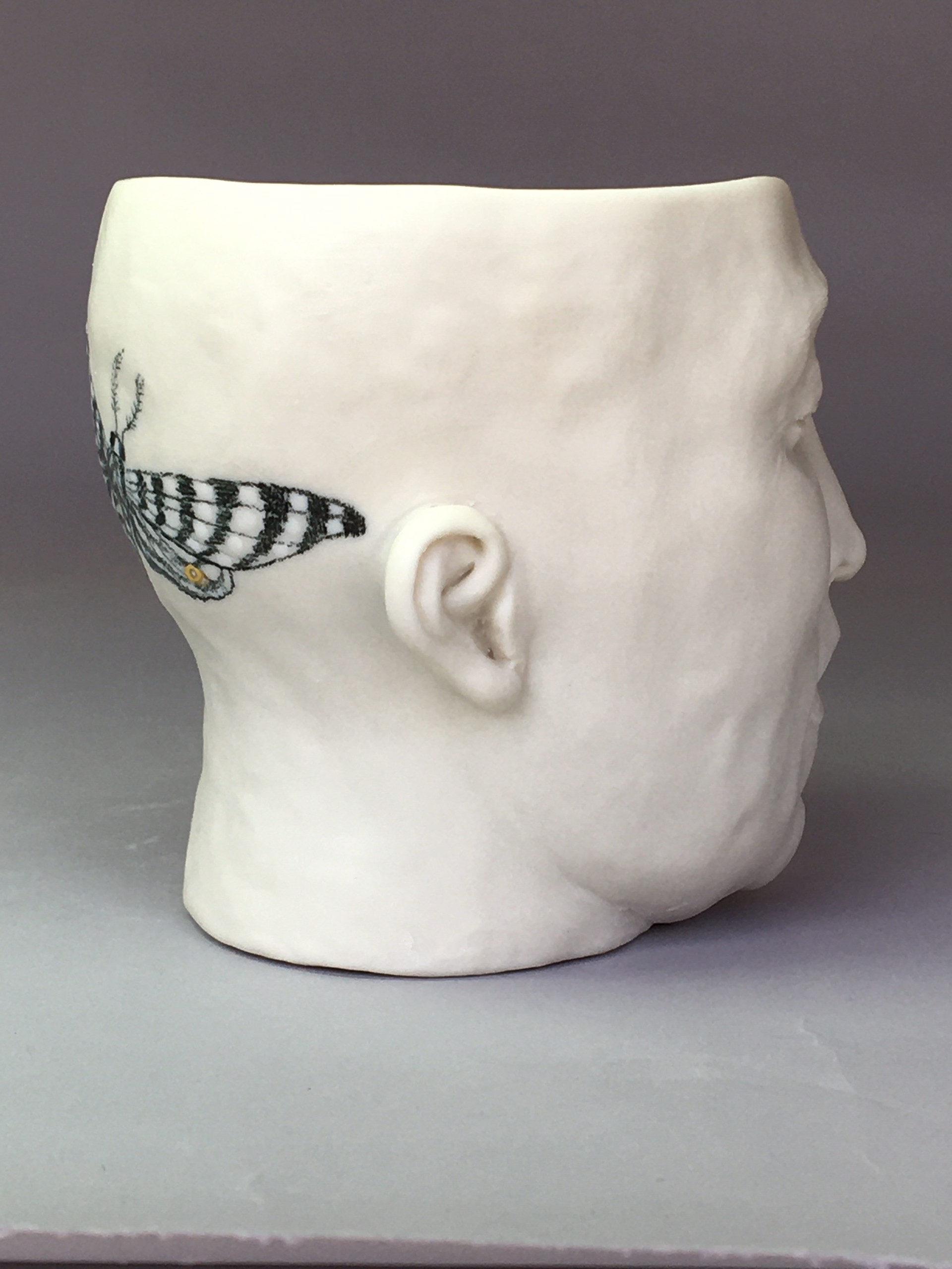 """Moth Cup I"" (back of head, light blue celadon, eyes closed) by Adrian Arleo"