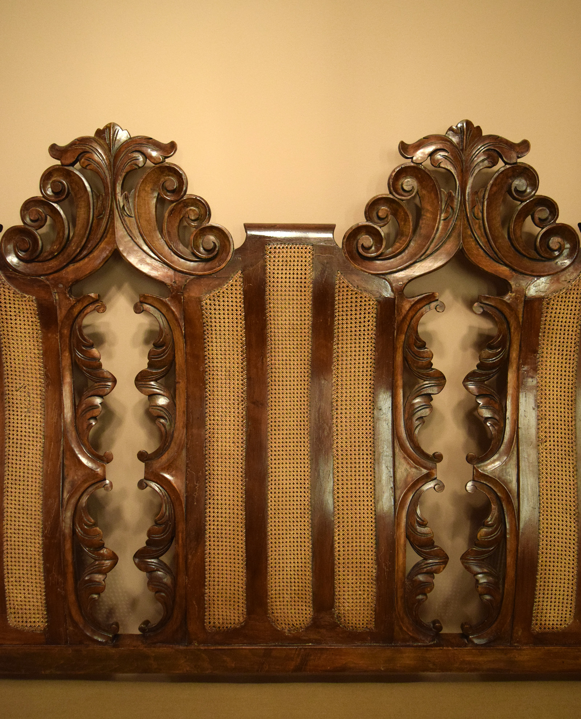 WALNUT AND CANED TRIPLE CHAIR-BACK SETTEE