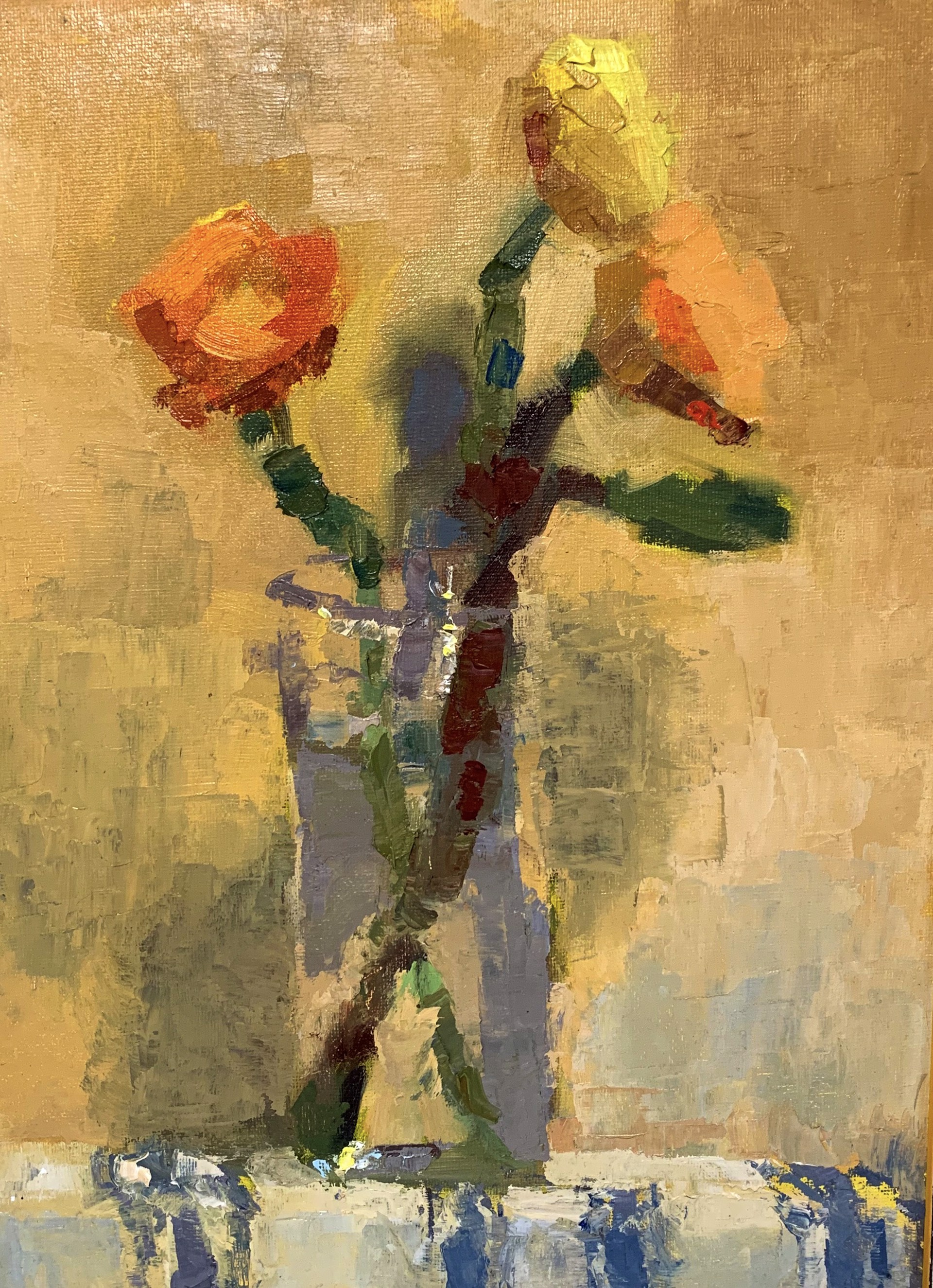 Orange and Yellow Ranunculus  by Laura Murphey