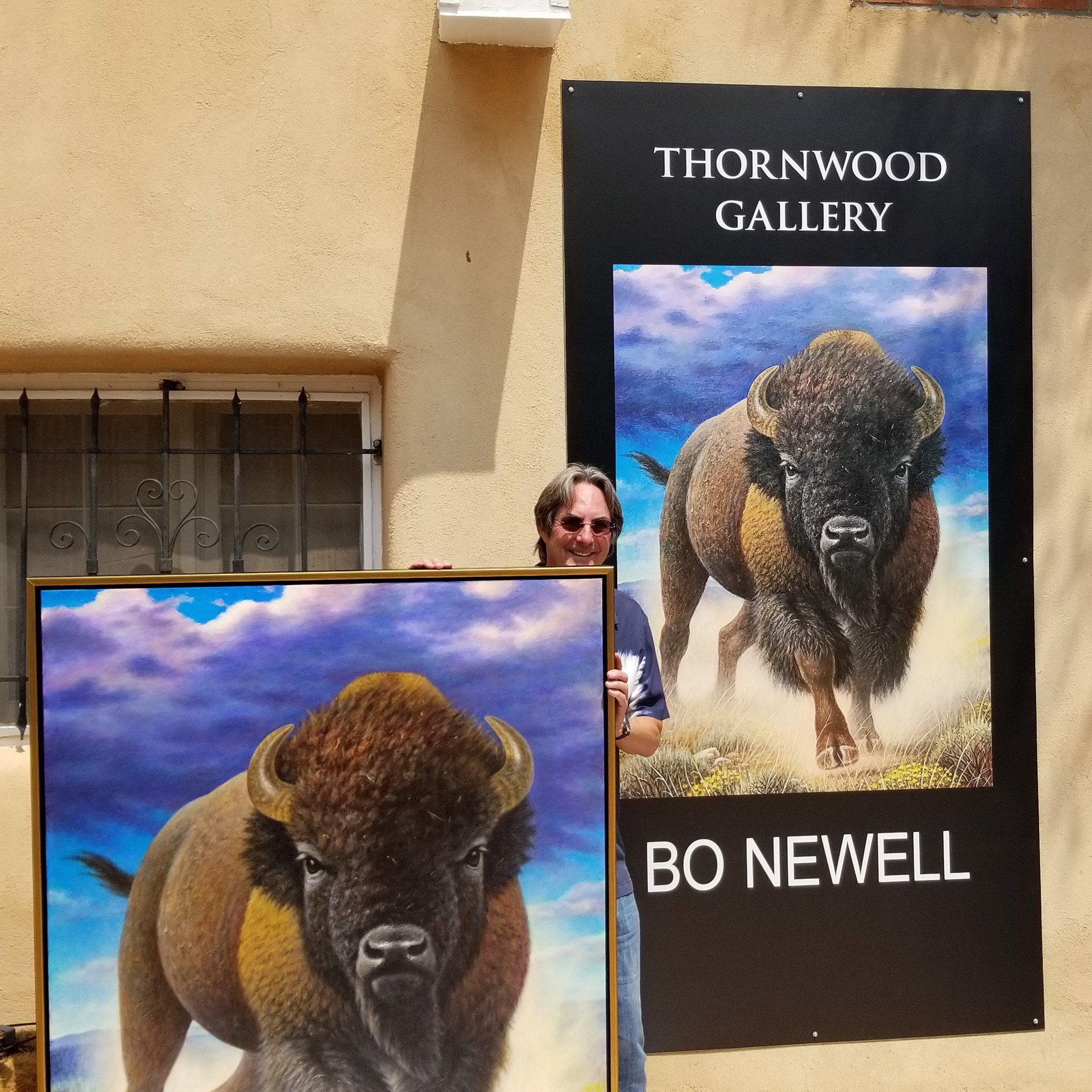 """Bo Newell Next to Gallery Banner with New Arrival: """"Unchallenged"""" by Bo Newell"""