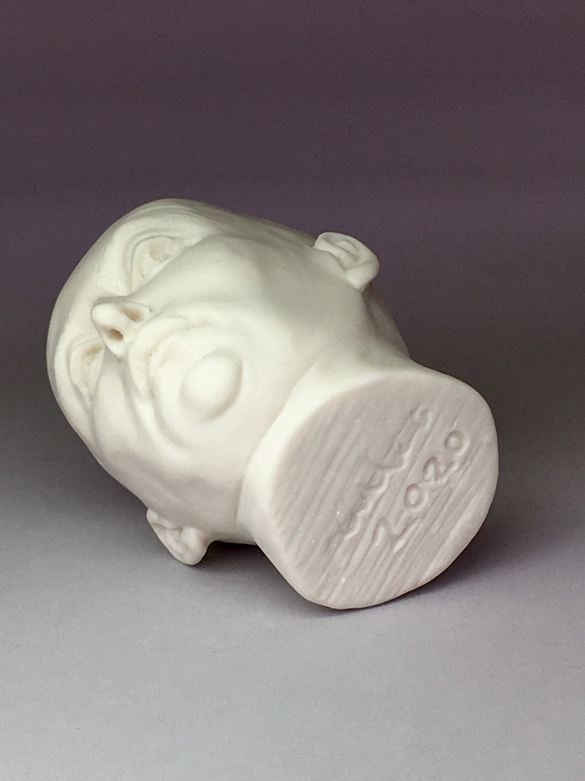 """Skeptical Friend Shot Glass I"" (pink interior, eyes open, curvy nose) by Adrian Arleo"