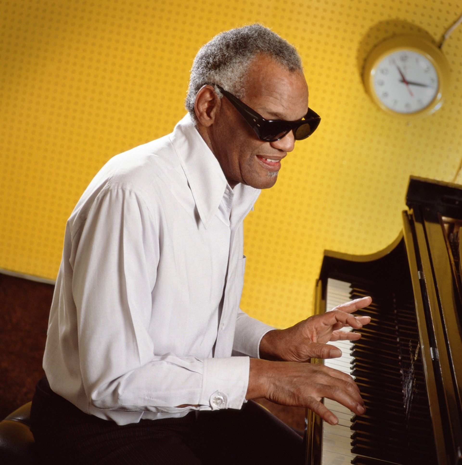 88097 Ray Charles Playing Piano Against Yellow Color by Timothy White