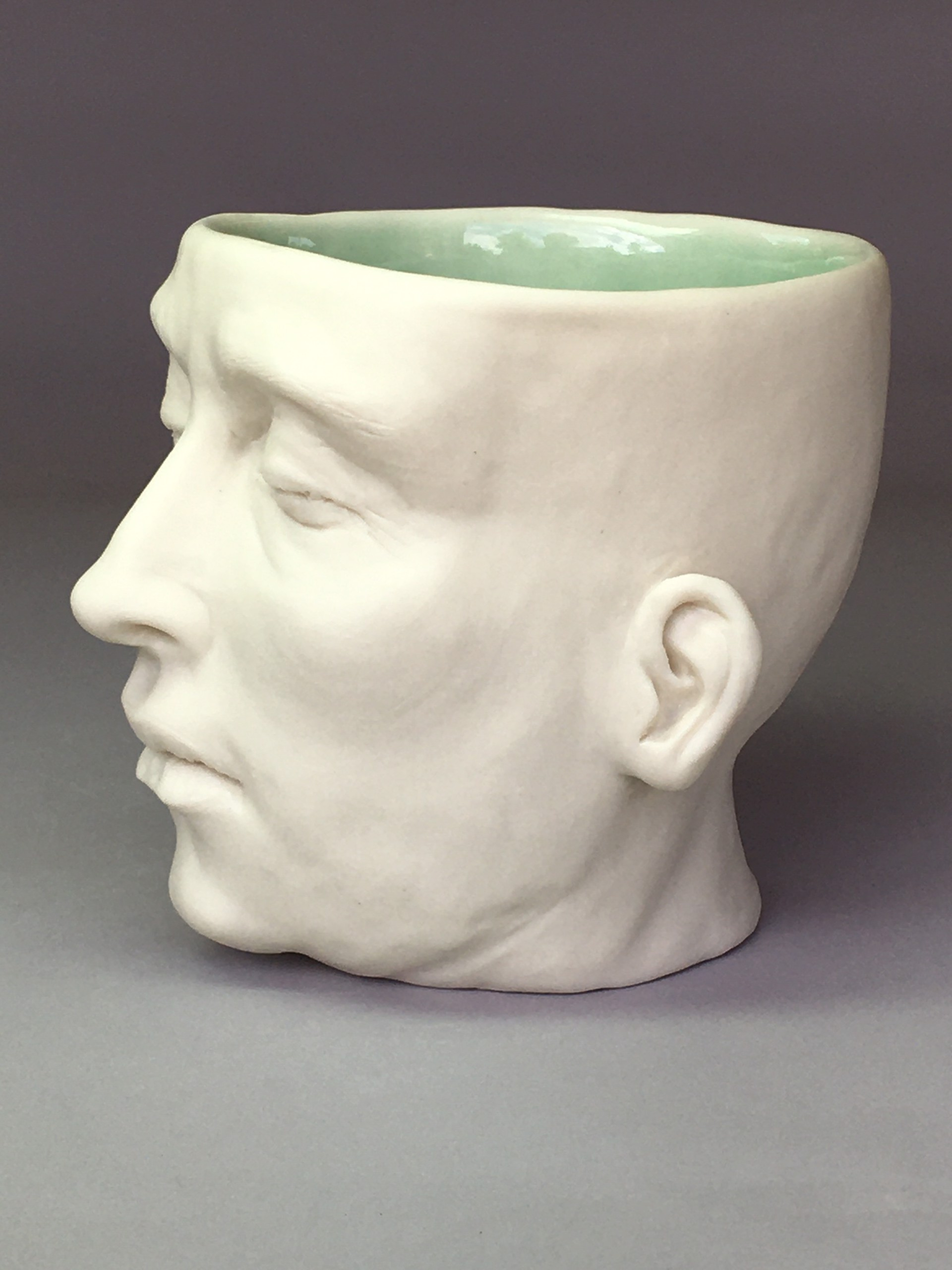 """""""Moth Cup II"""" (right side low, light green celadon, eyes closed) by Adrian Arleo"""