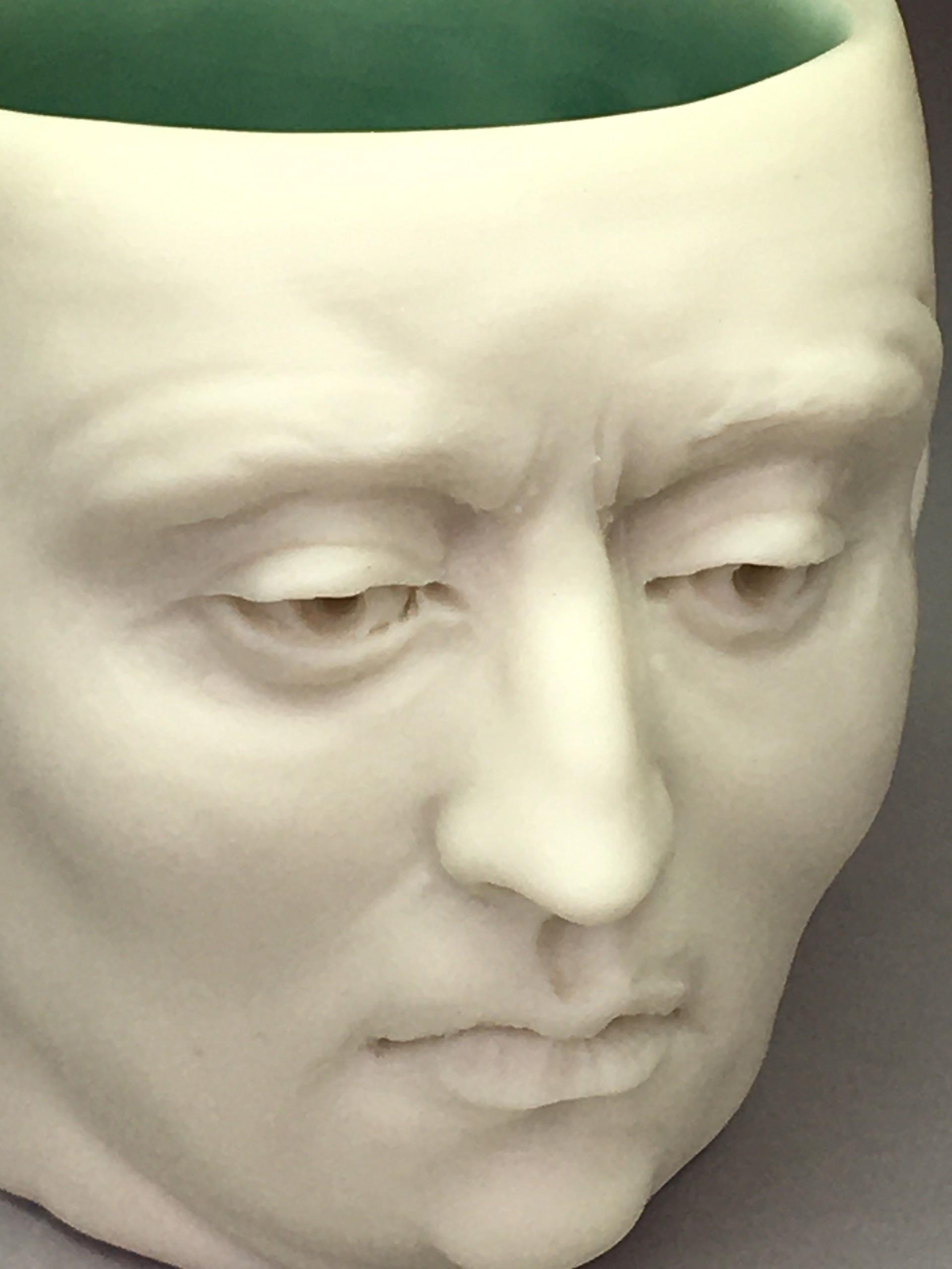 """Concerned Friend Shot Glass II"" (dark green interior, eyes open) by Adrian Arleo"