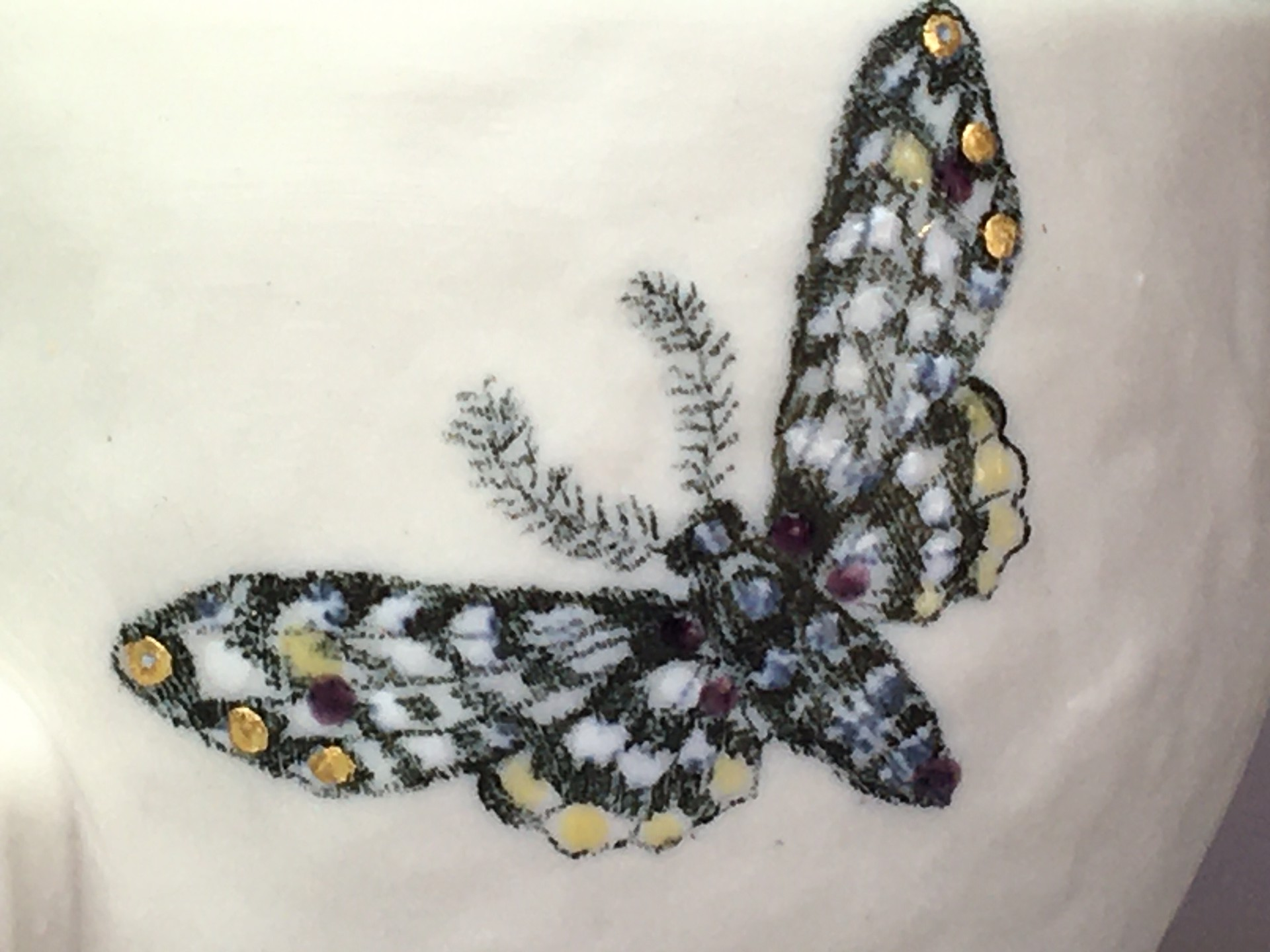 """""""Moth Cup IV"""" (right side, black matte, eyes closed) by Adrian Arleo"""