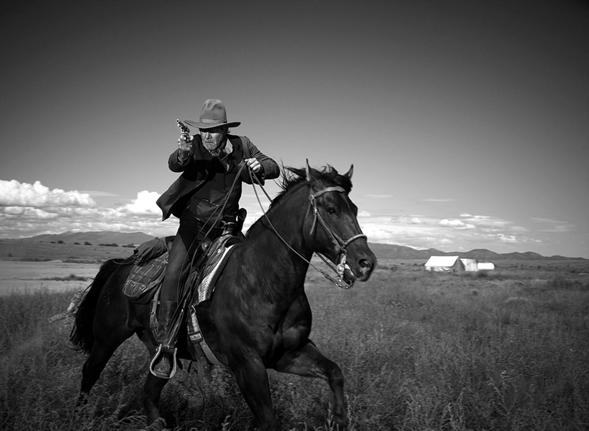 10018 Harrison Ford Riding the Horse BW by Timothy White