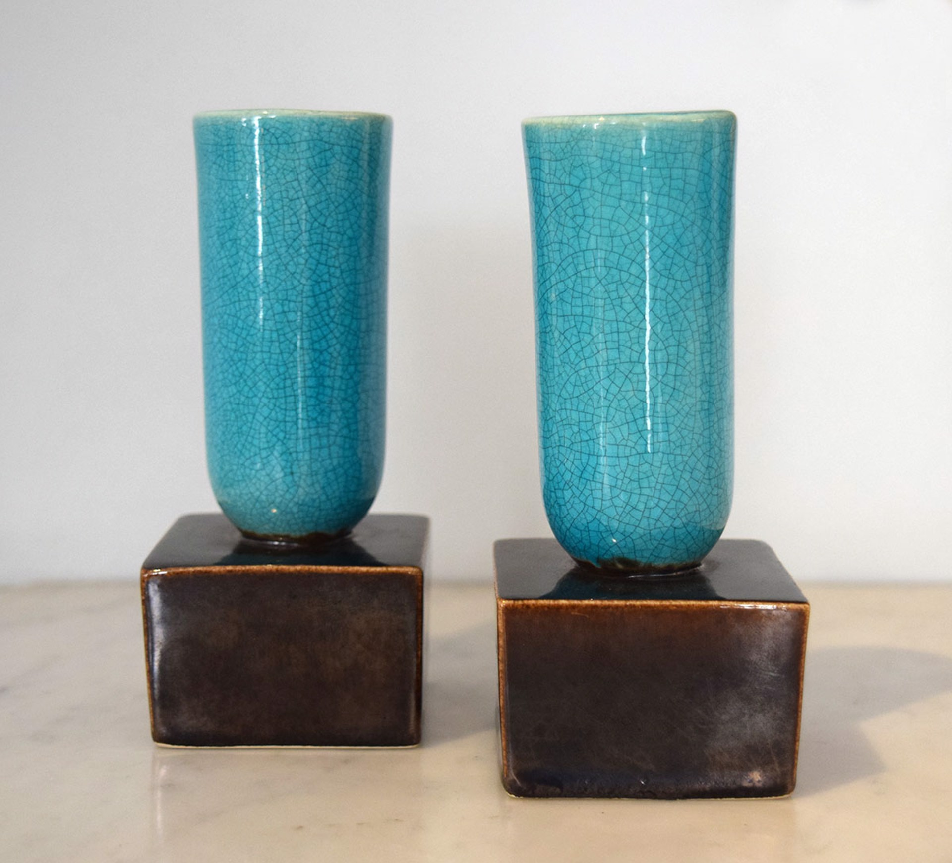 PAIR OF TURQUOISE AND AUBERGINE GLAZED AMERICAN POTTERY CANDLESTICKS