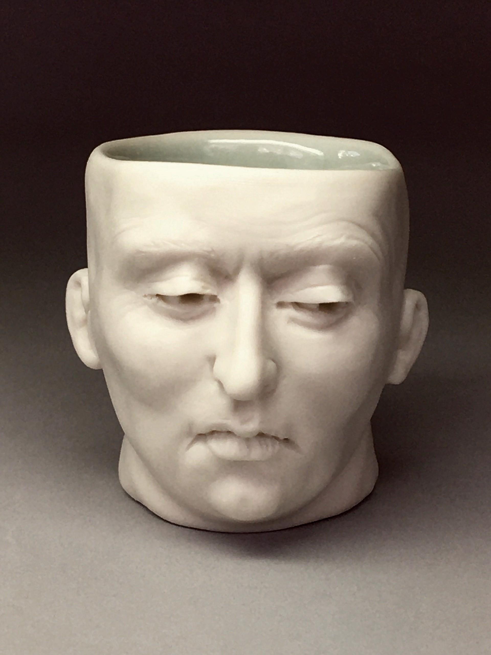 """Skeptical Friend Shot Glass II"" (light blue interior, open eyes) by Adrian Arleo"