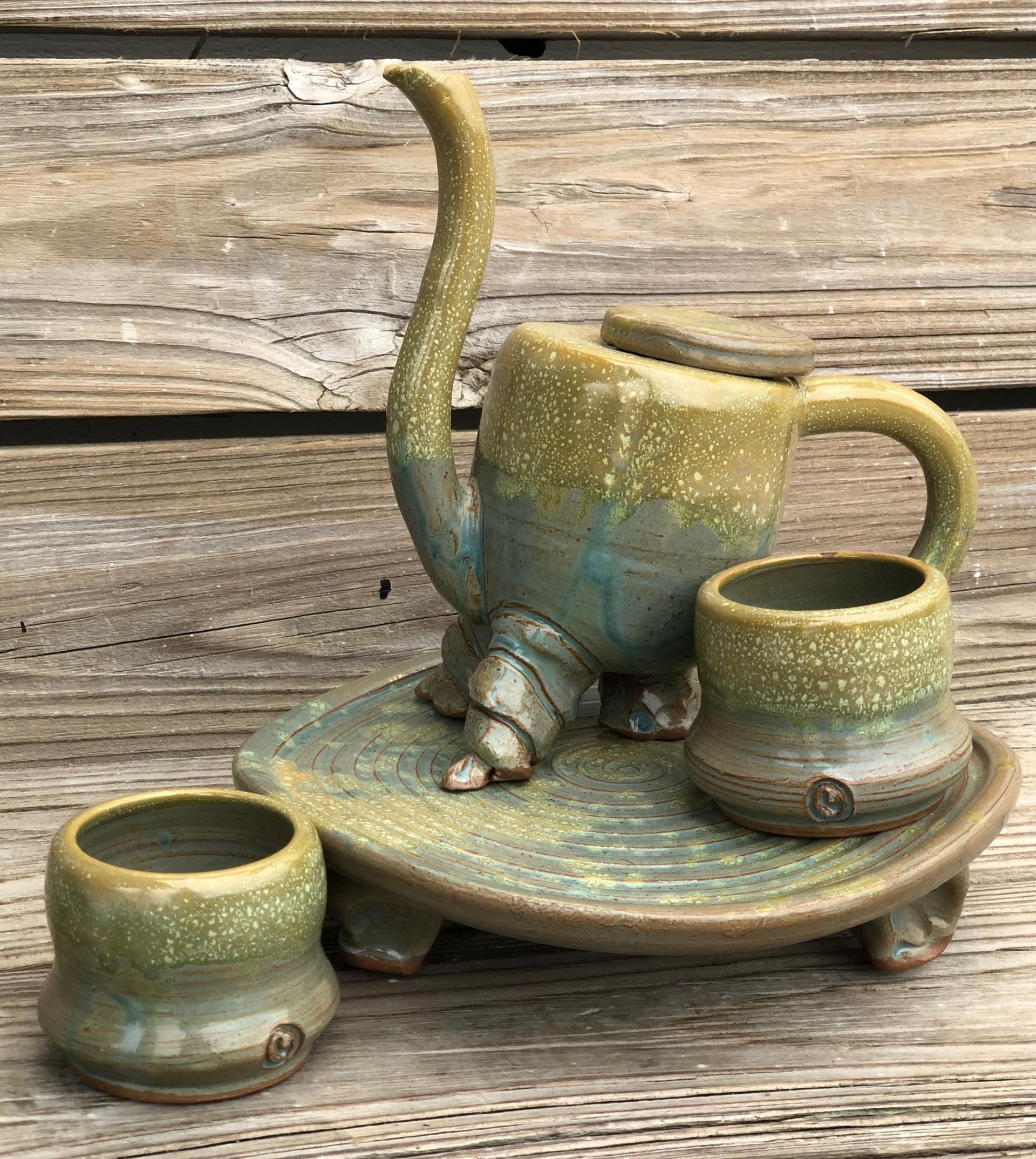 Dancing Tea Pot, mugs and stand by Jim Jones