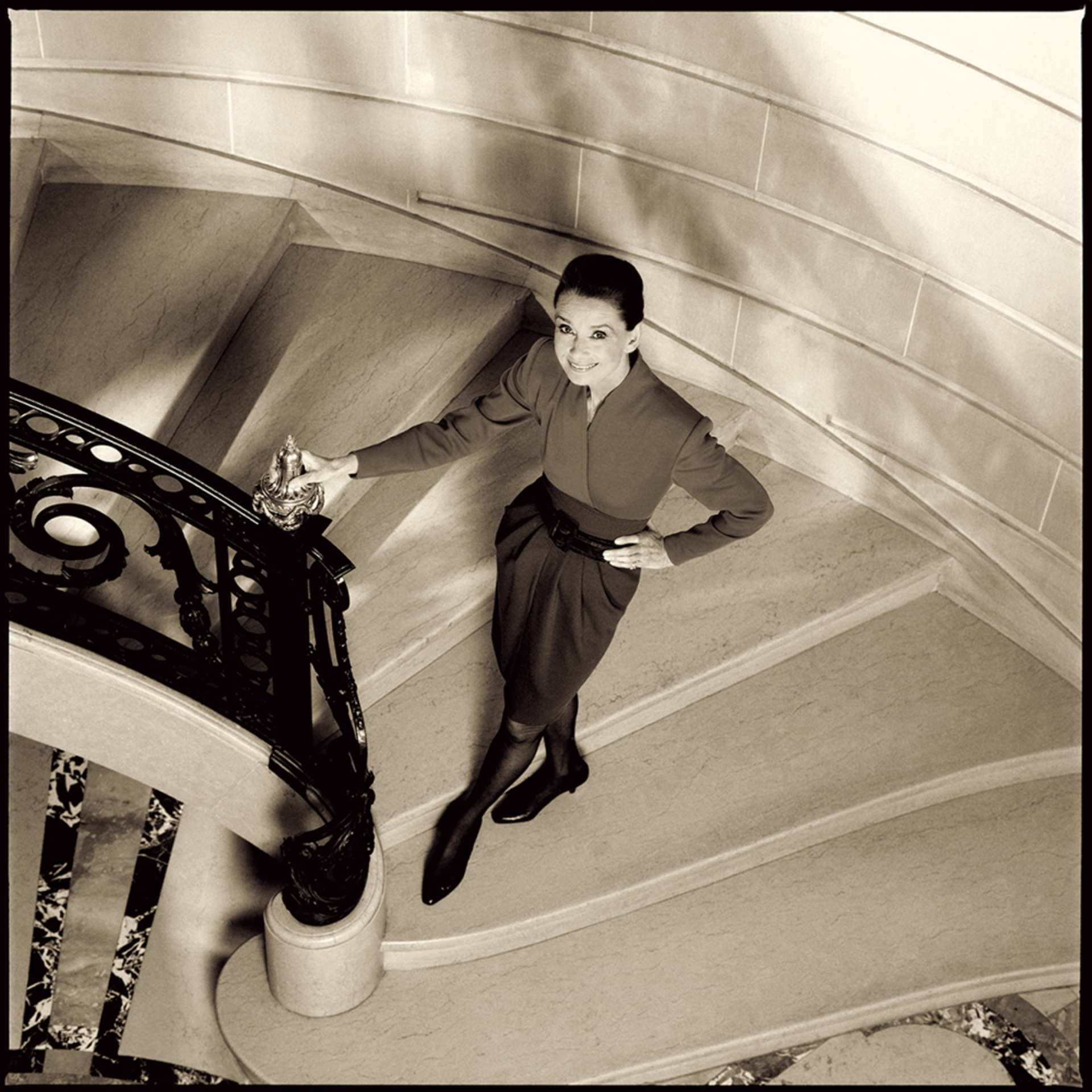 89003 Audrey Hepburn Smiling in Stairway Sepia by Timothy White