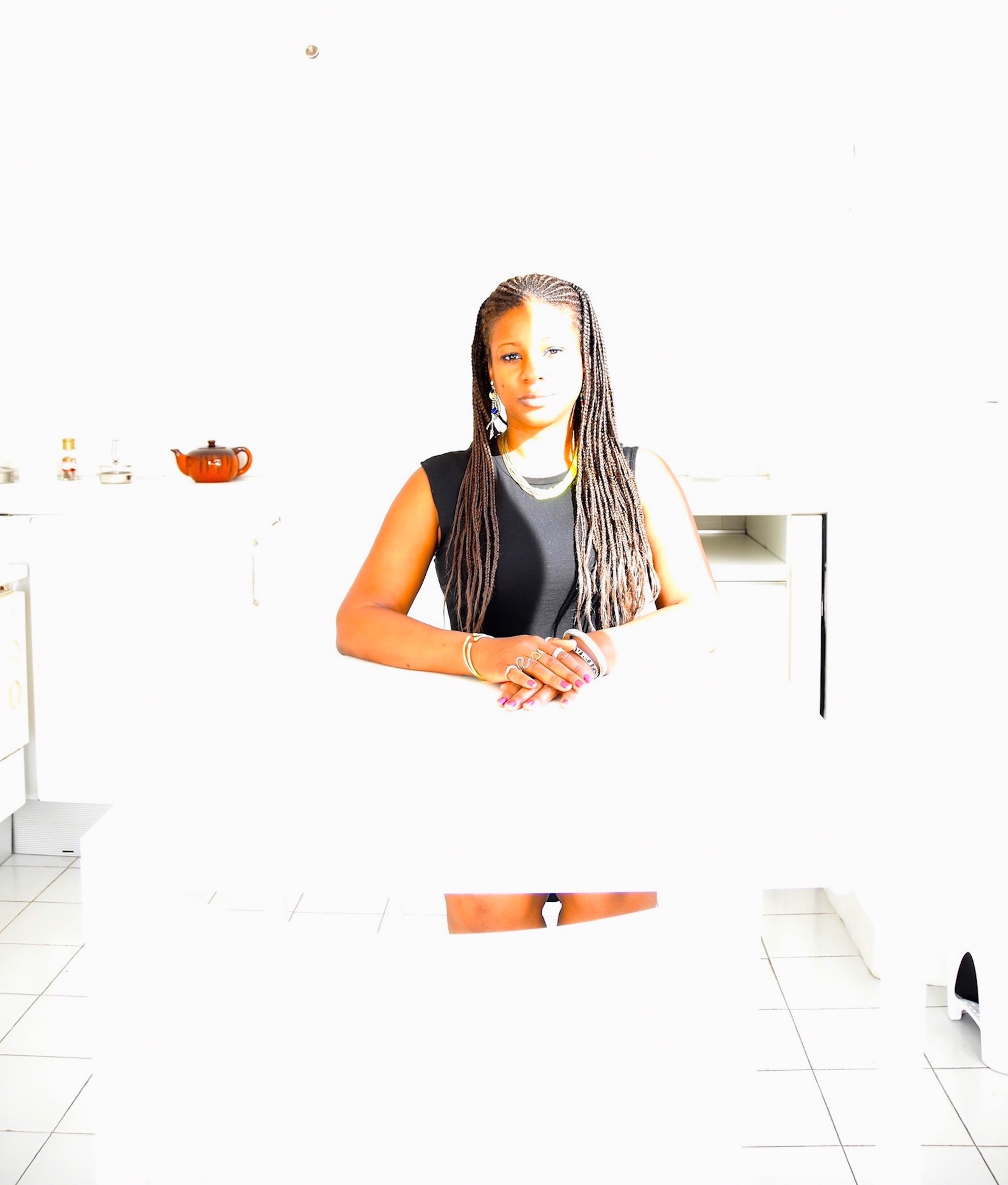 Brown Girl Seated At the White Kitchen Table 0010 by Amber Robles-Gordon