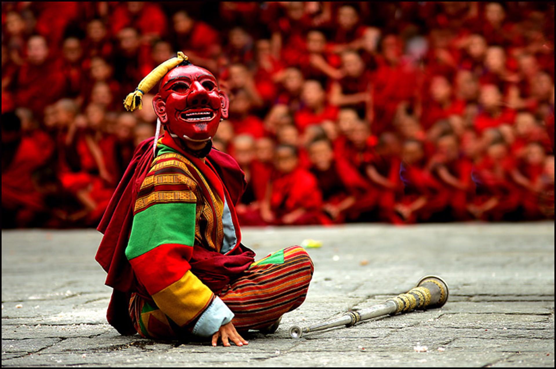 Masked Dancer at Tsechu Festival by Oksana Perkins