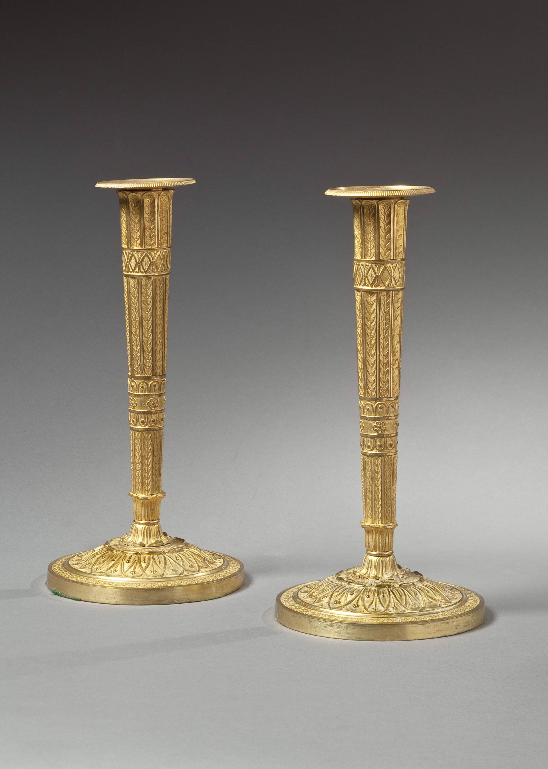 PAIR OF FRENCH GILT-BRONZE CANDLESTICKS