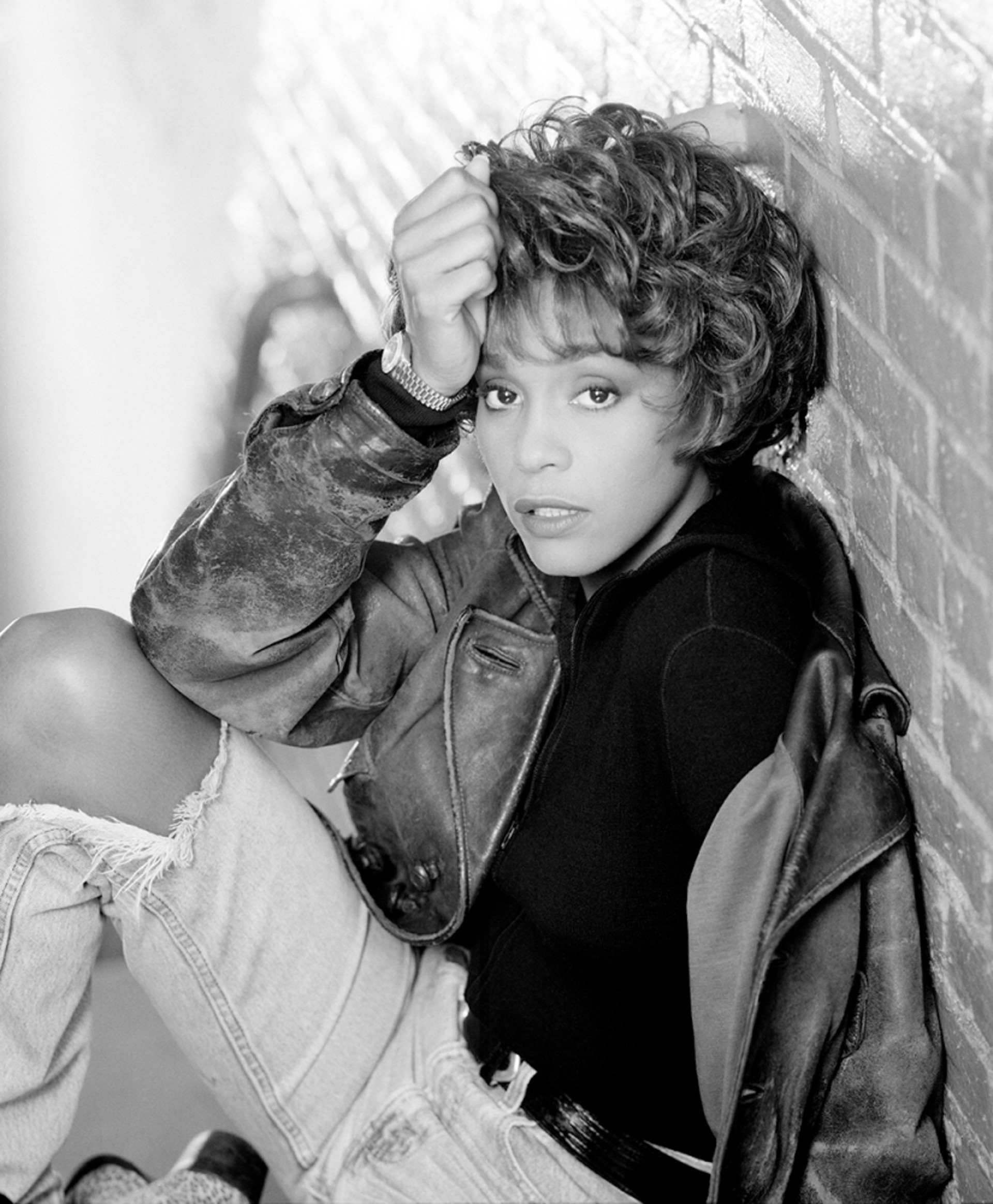 90115 Whitney Houston Crouching Against Brick Wall BW by Timothy White