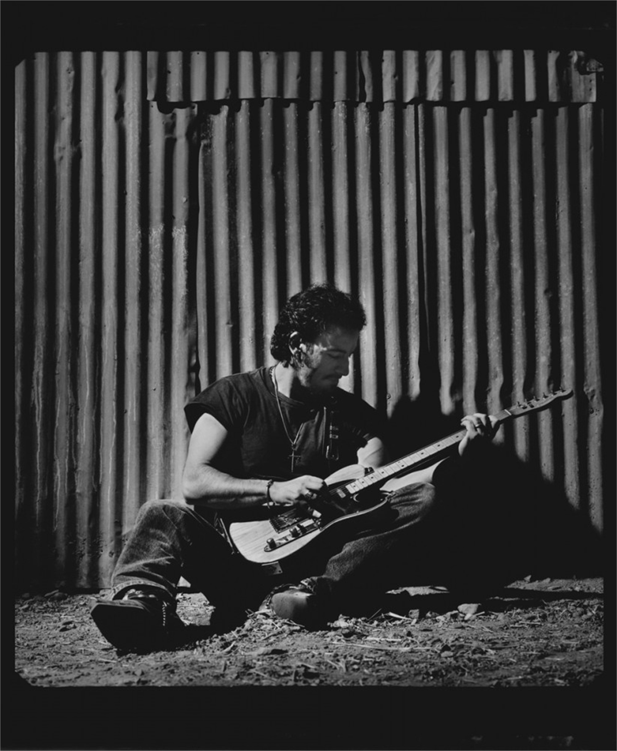91152 Bruce Springsteen Seated on Corrugated Wall BW by Timothy White
