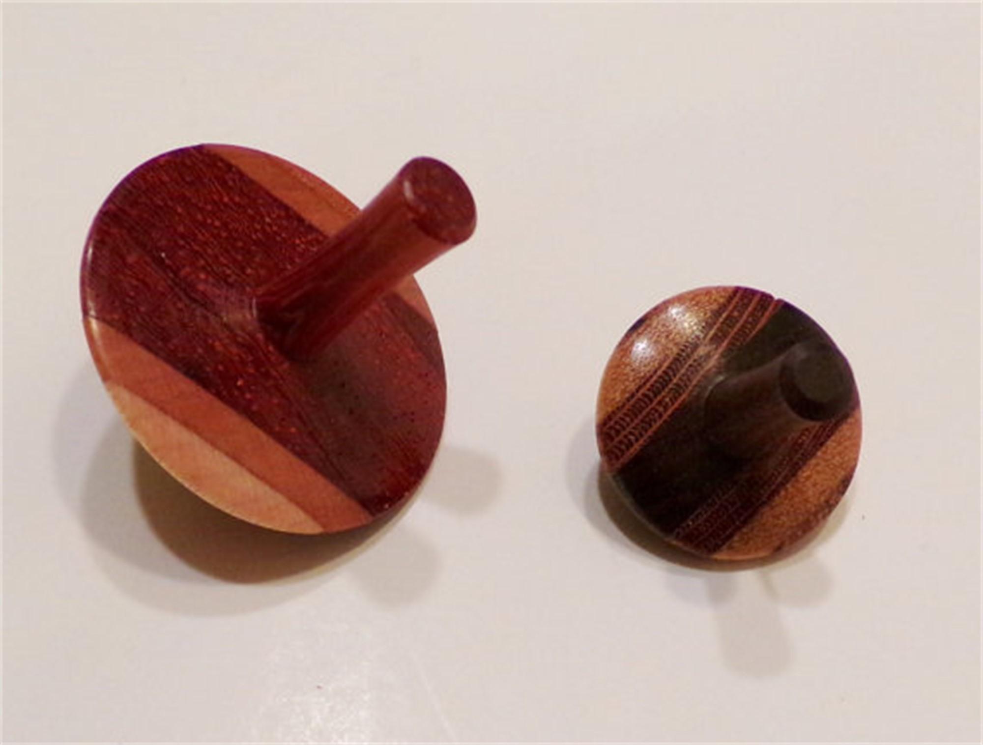 Wooden spinning tops by Bill Wanezek