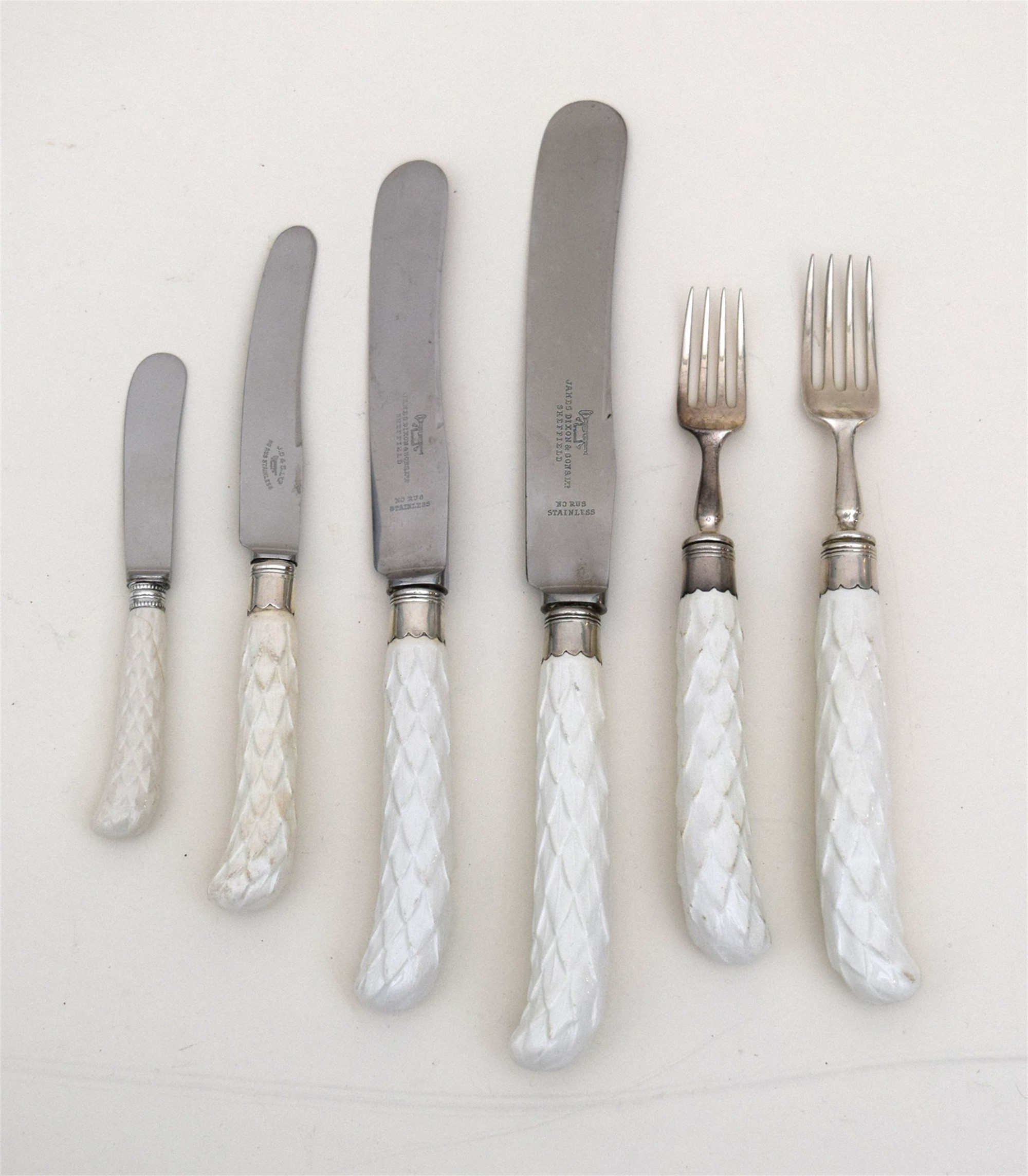 ENGLISH SILVER AND PORCELAIN FLATWARE SERVICE