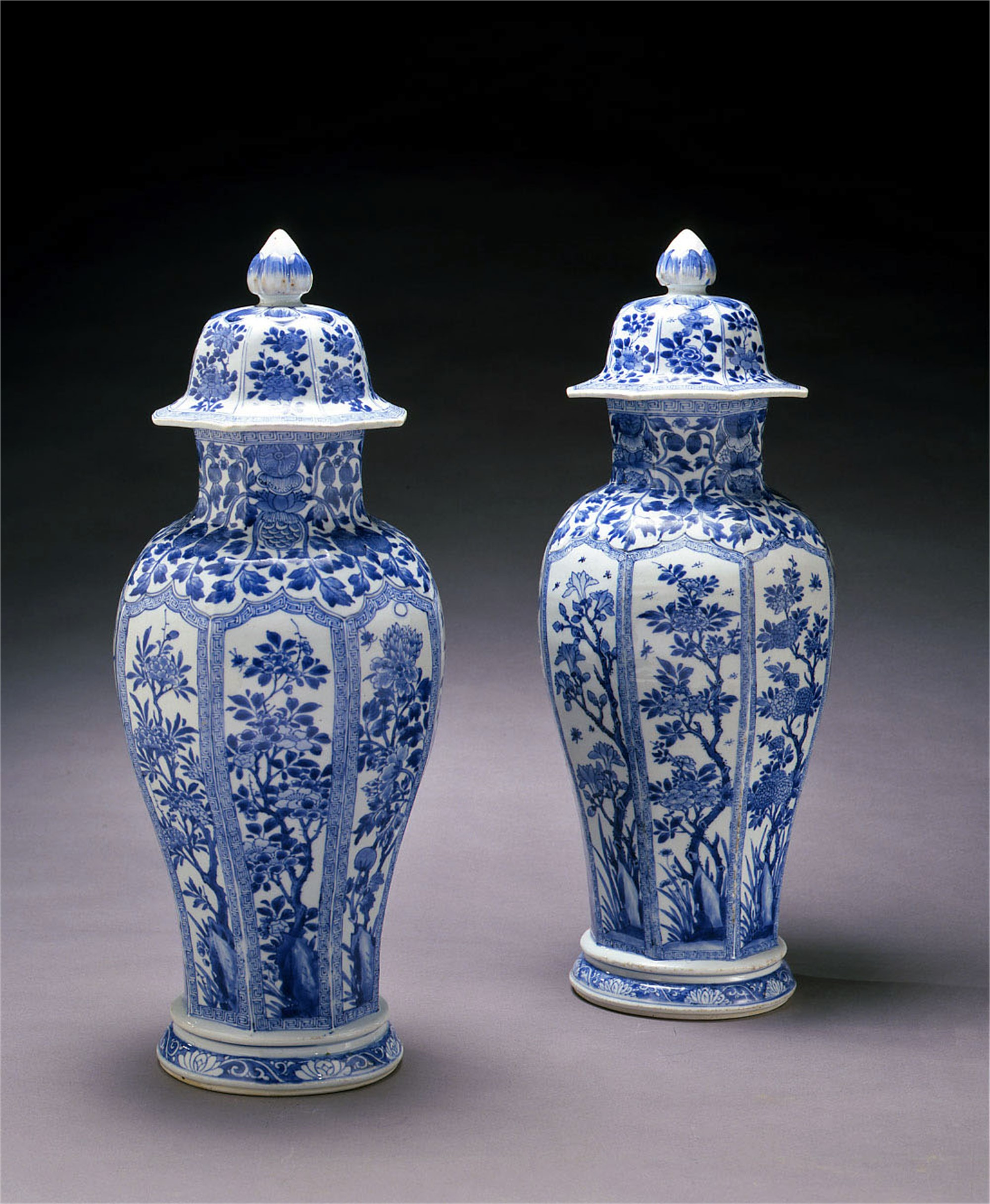 PAIR OF BLUE AND WHITE VASES WITH COVERS