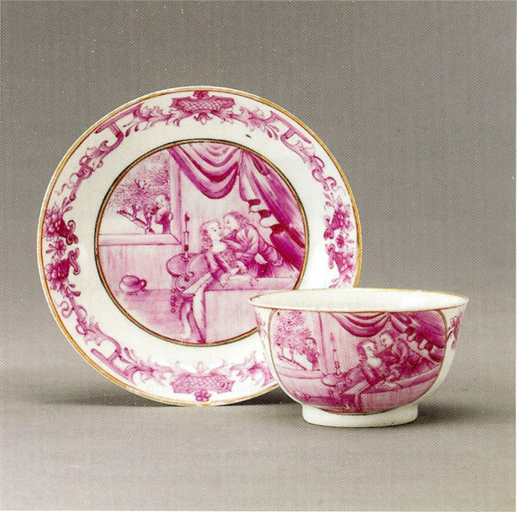"PUCE TEABOWL AND SAUCER WITH ""PEEPING TOM"""