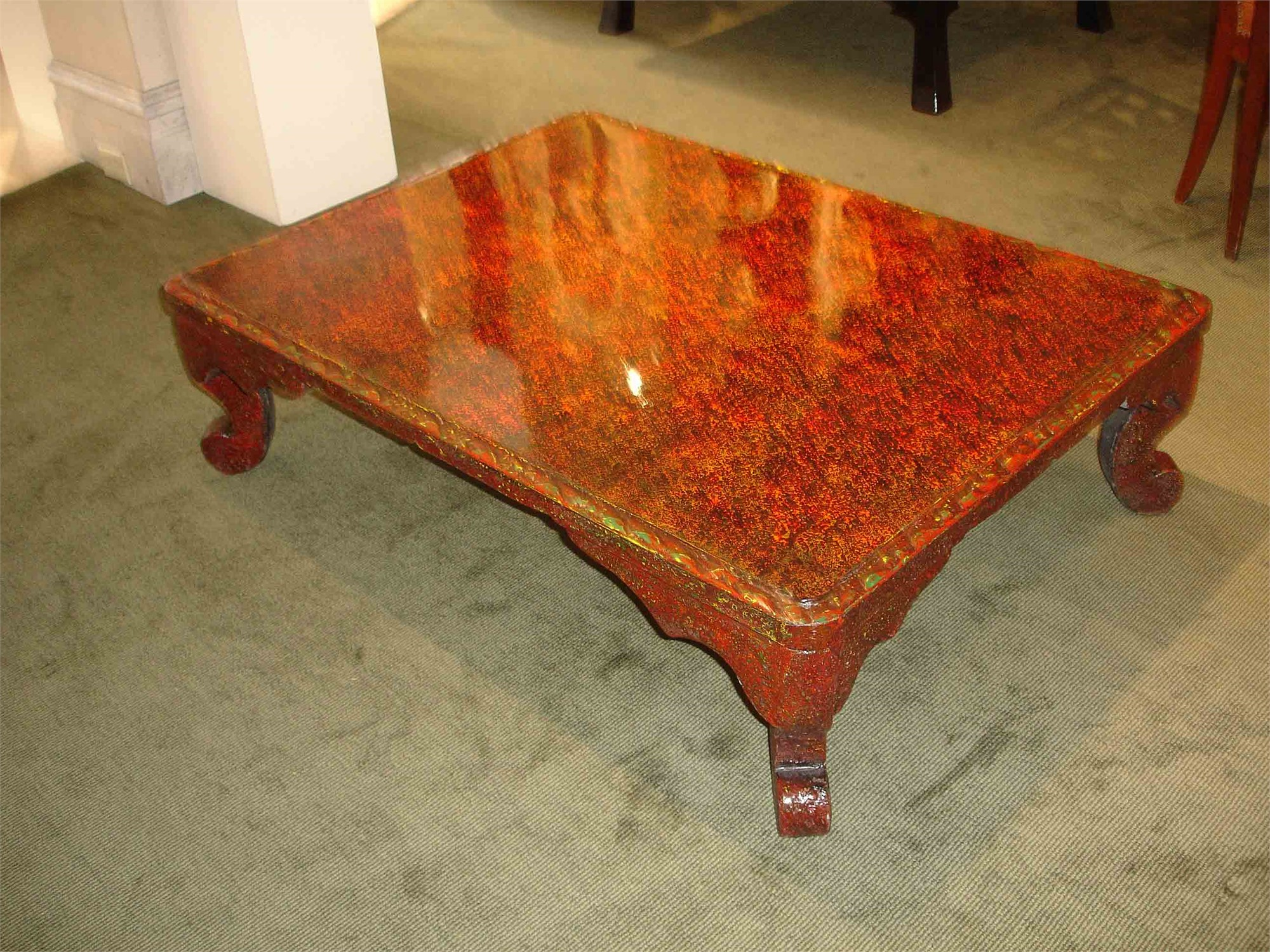 SINGLE RED LACQUER LOW TABLE WITH BAROQUE LEGS