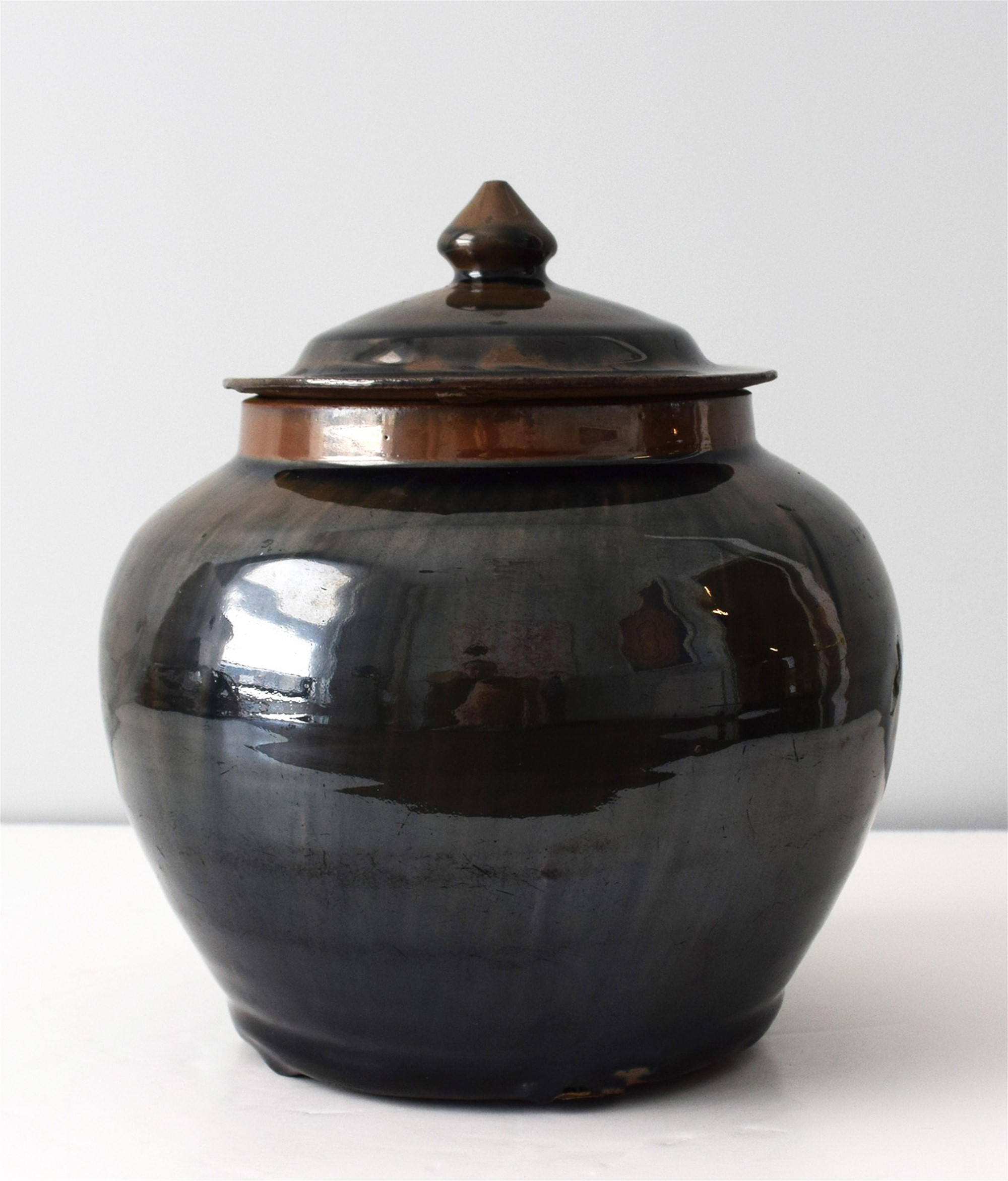 BLACK GLAZED JAR AND COVER WITH RUSSET STREAKS