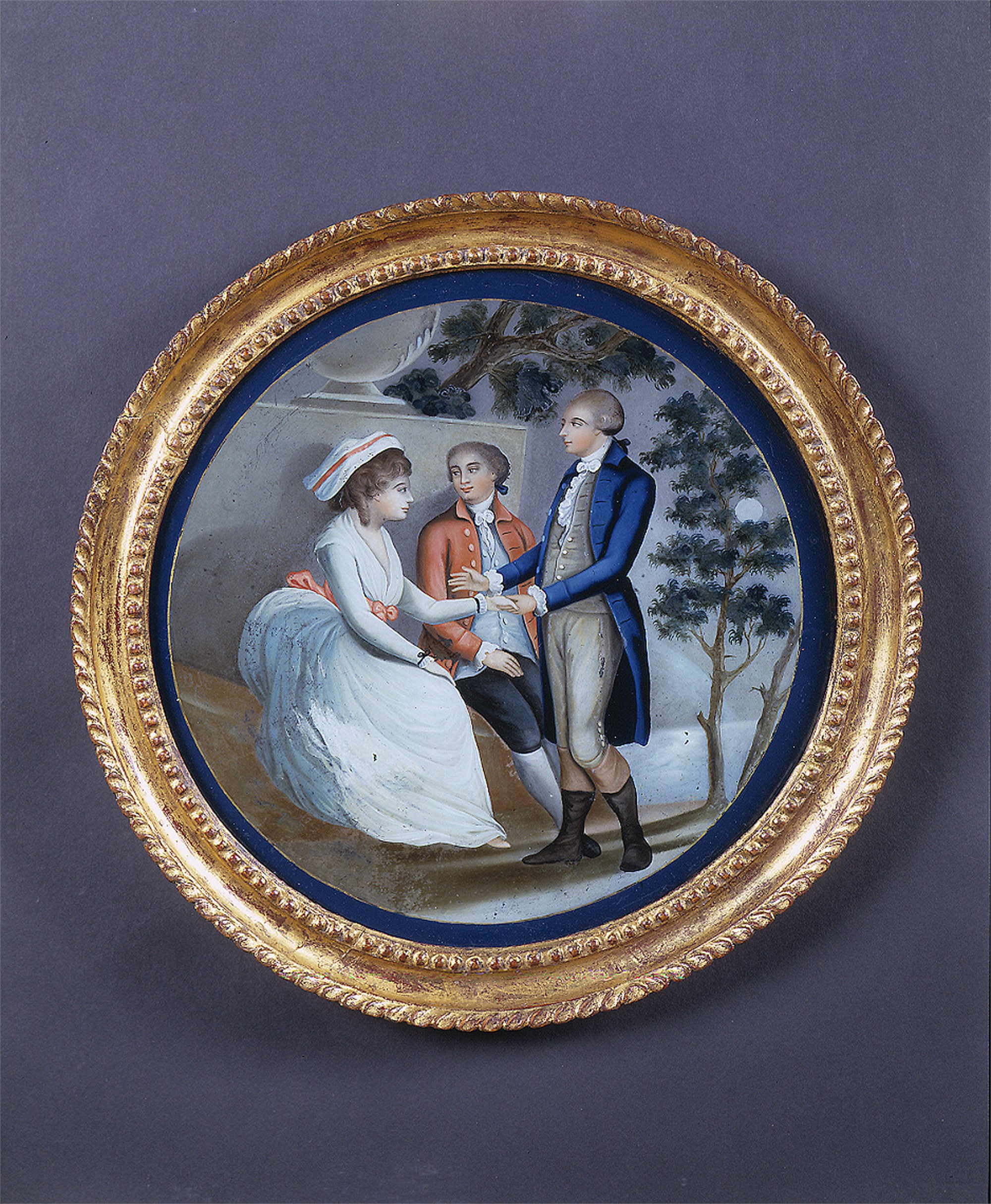 ROUND REVERSE PAINTING ON GLASS WITH TWO MEN COURTING LADY BY TREE
