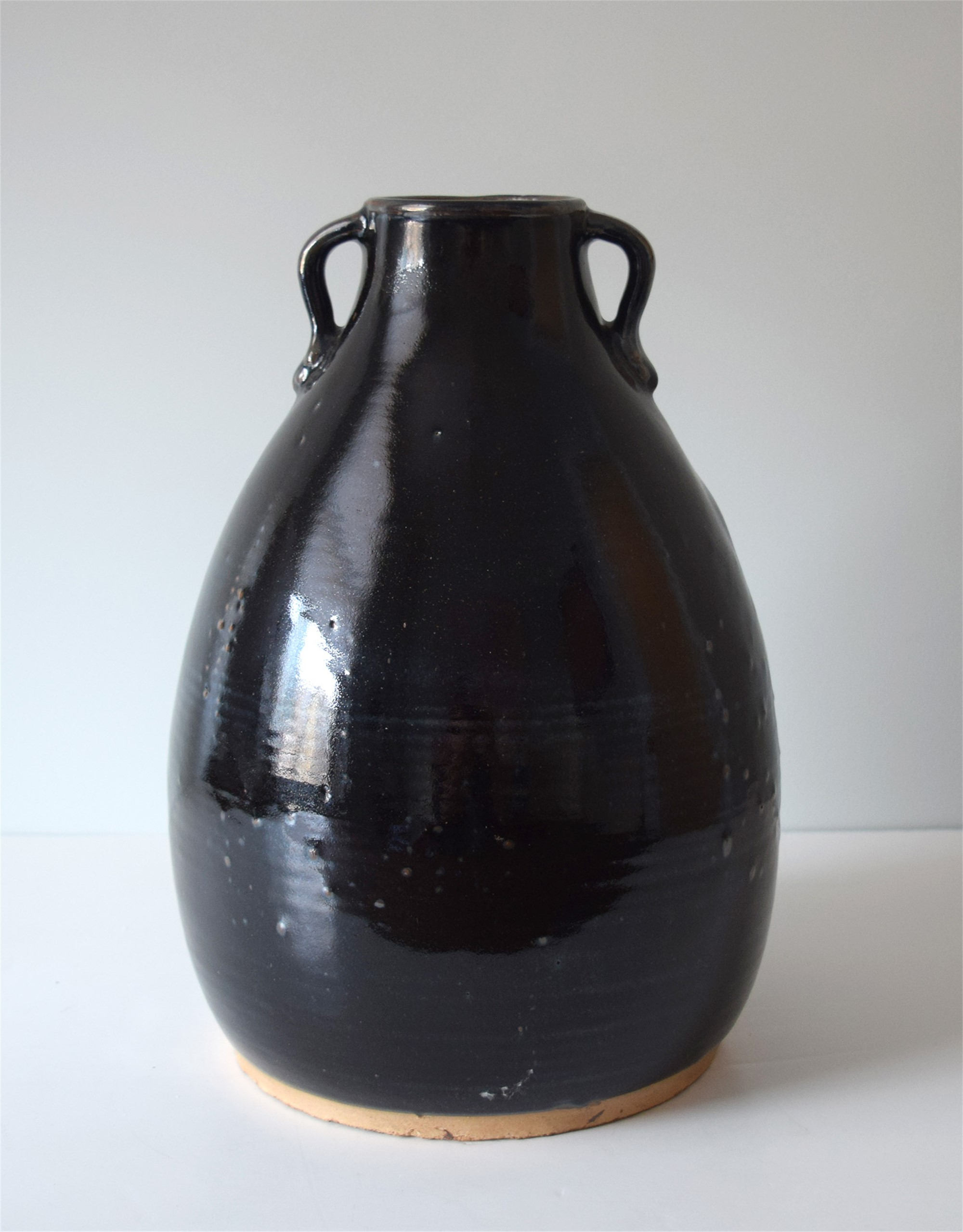 BLACK GLAZED JAR WITH EAR LOOP HANDLES