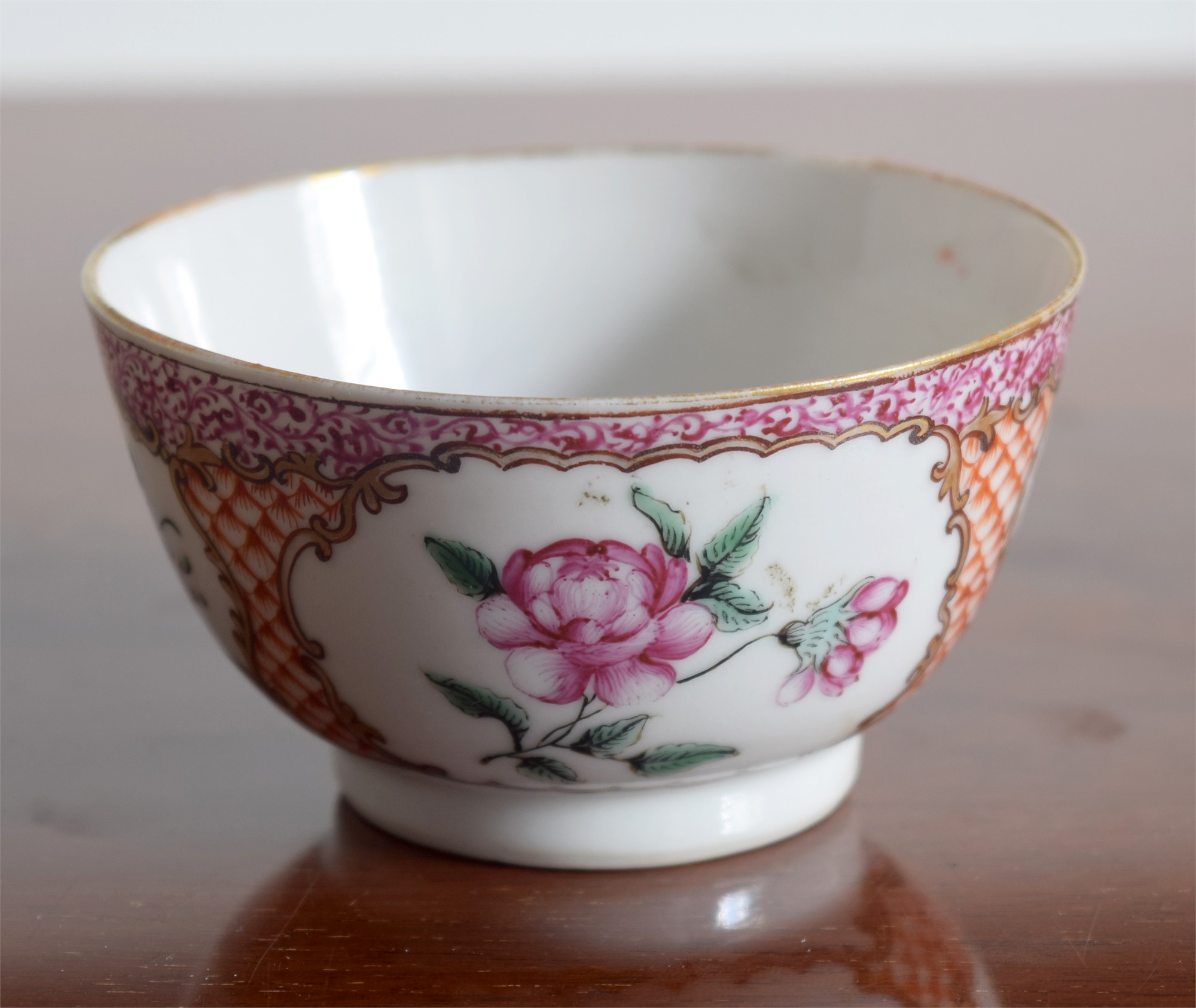 A FR CUP WITH CENTRAL FLOWER, SMALL PUCE FOLIAGE
