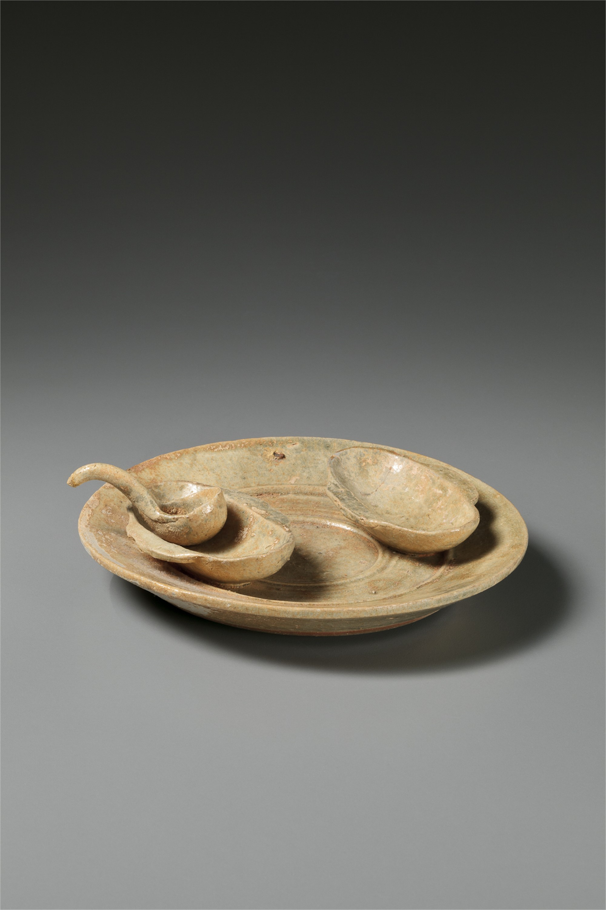 DISH WITH TWO EAR SHAPED CUPS AND A SMALL LADLE