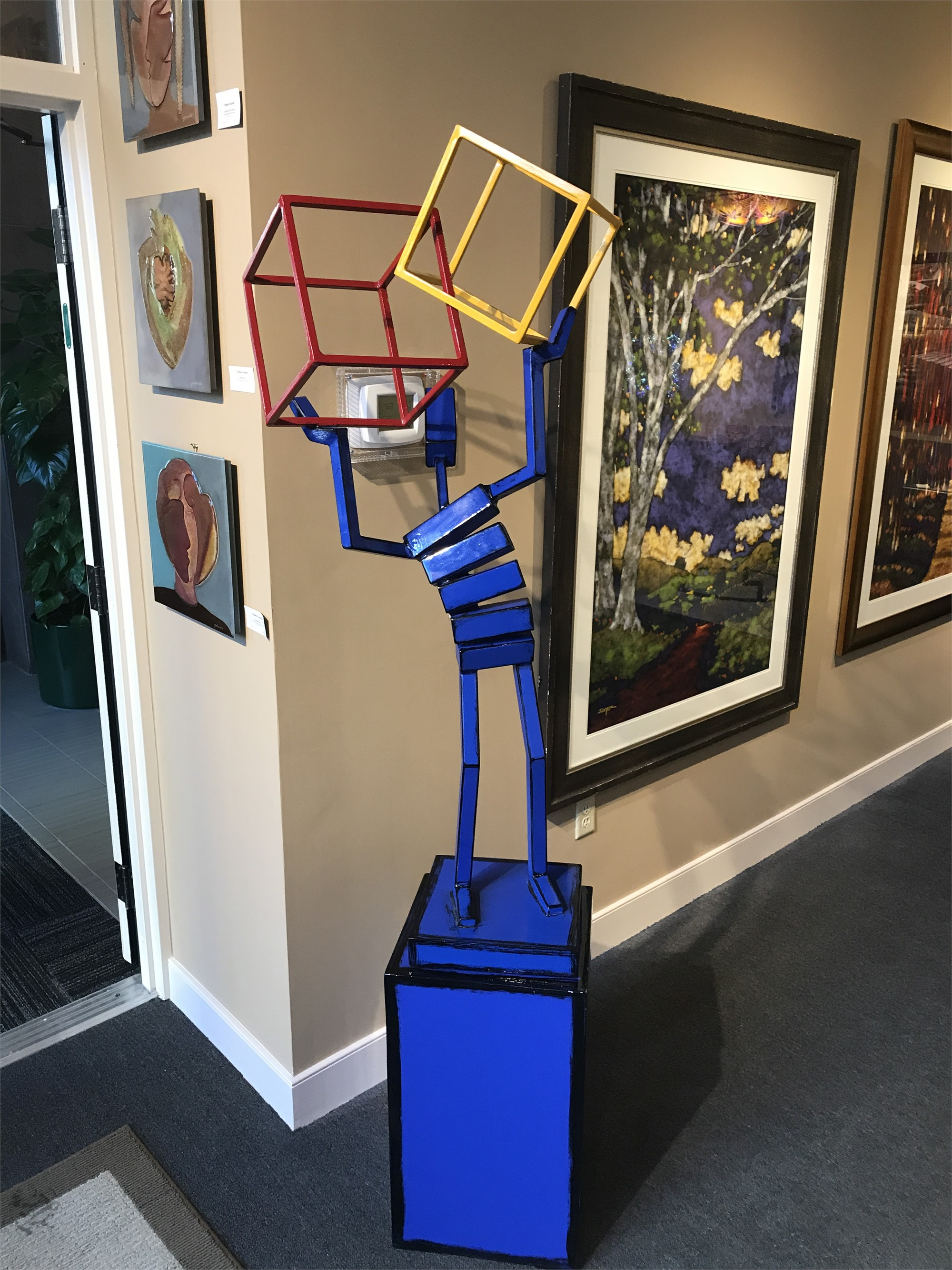 Figure w/ Intersecting Cubes by James Moore