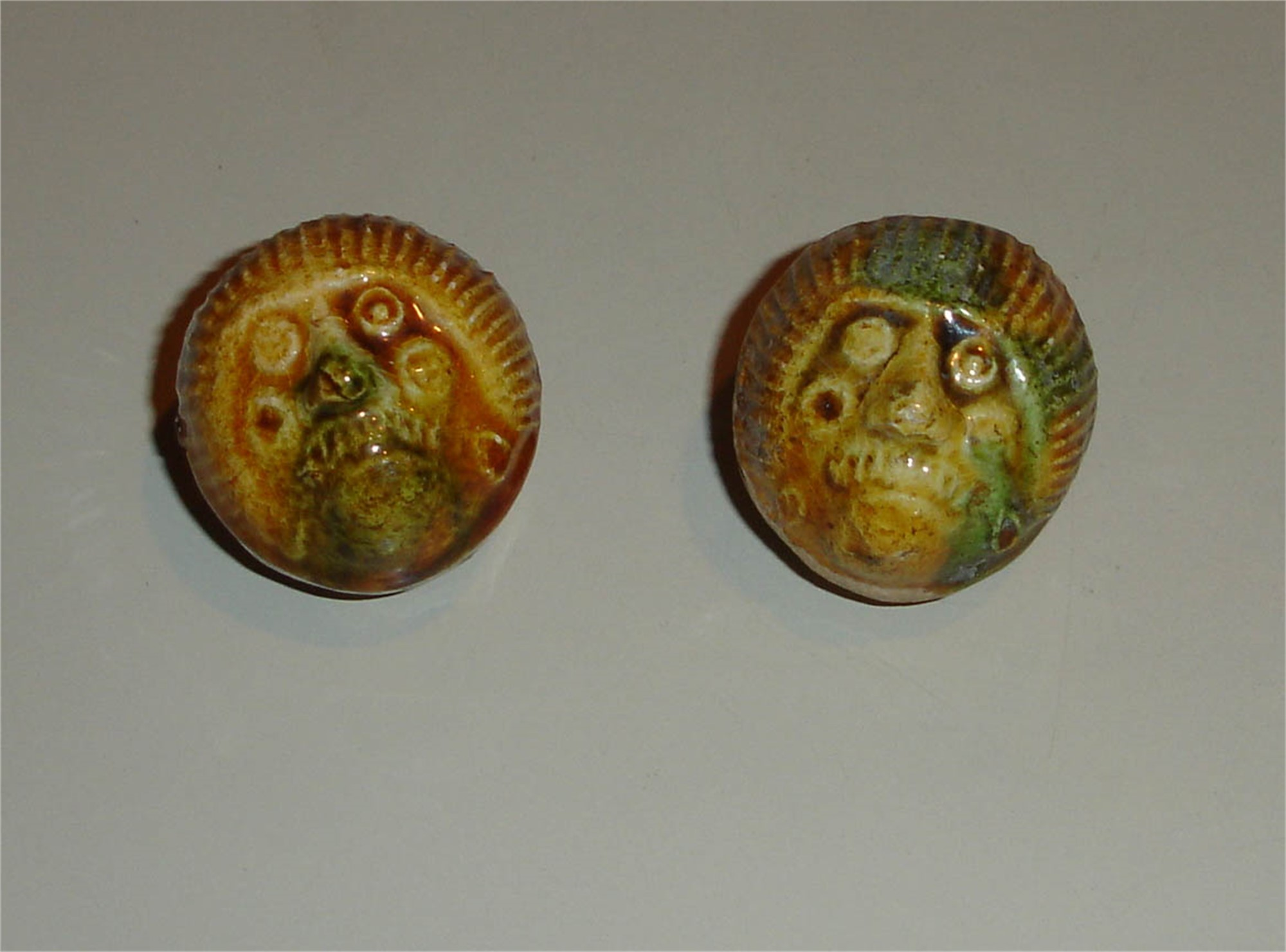 PAIR OF GLAZED POTTERY FIGURAL WHISTLES