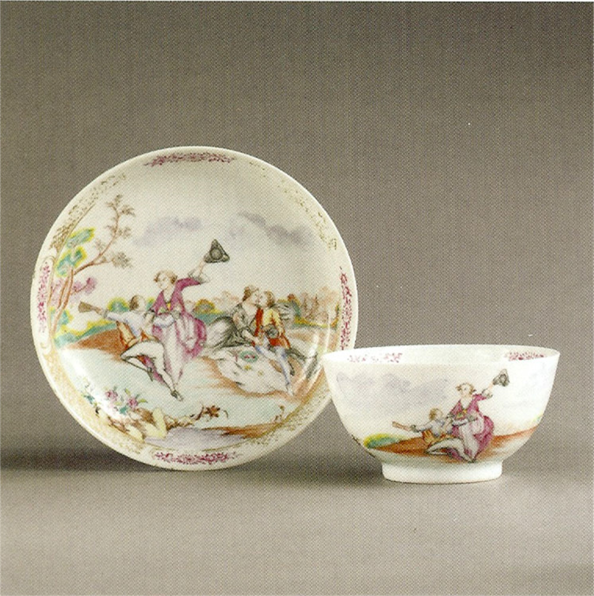 FAMILLE ROSE TEABOWL AND SAUCER WITH LOVERS IN A LANDSCAPE