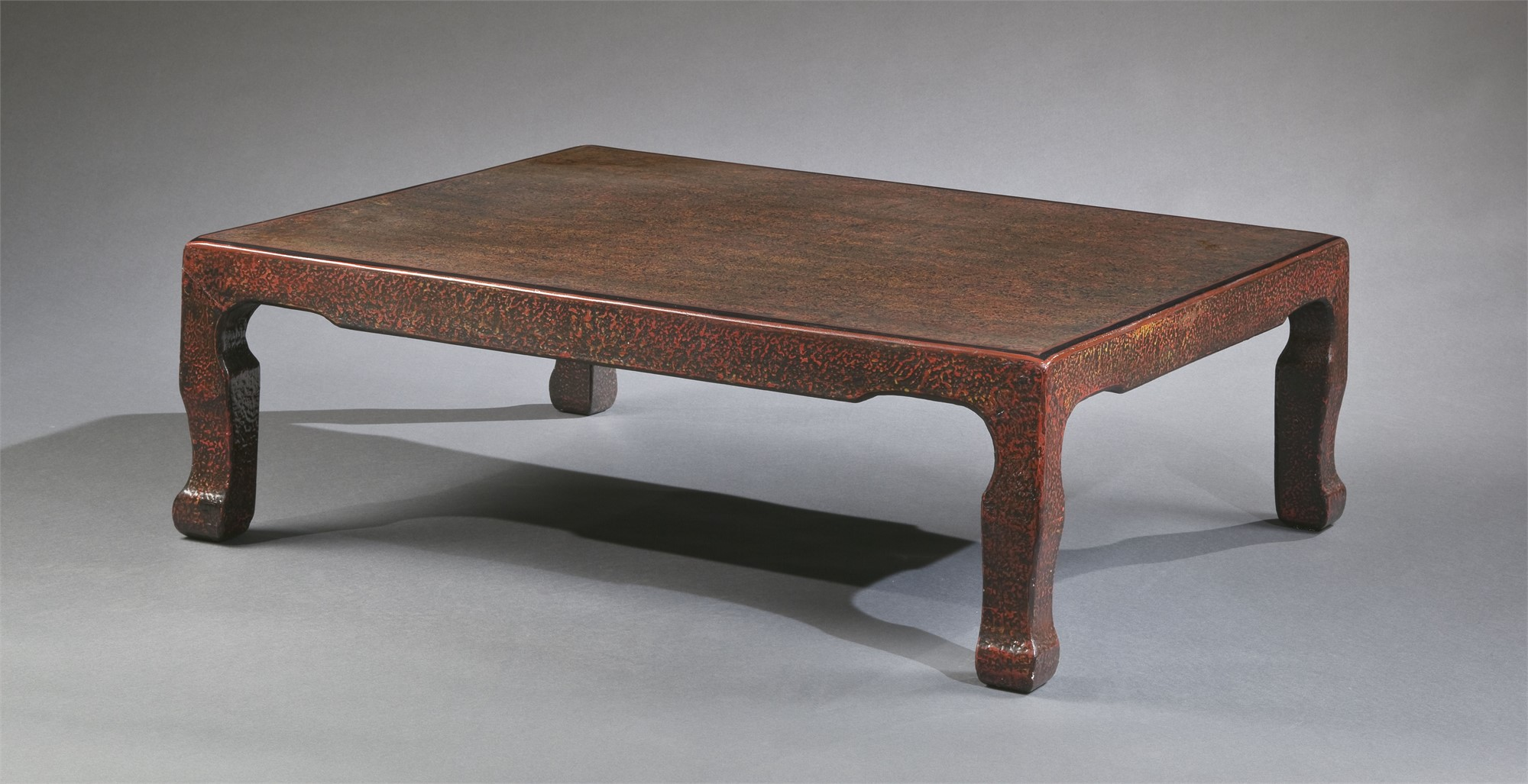 LOW LACQUER COFFEE TABLE WITH RED HIGHLIGHTS