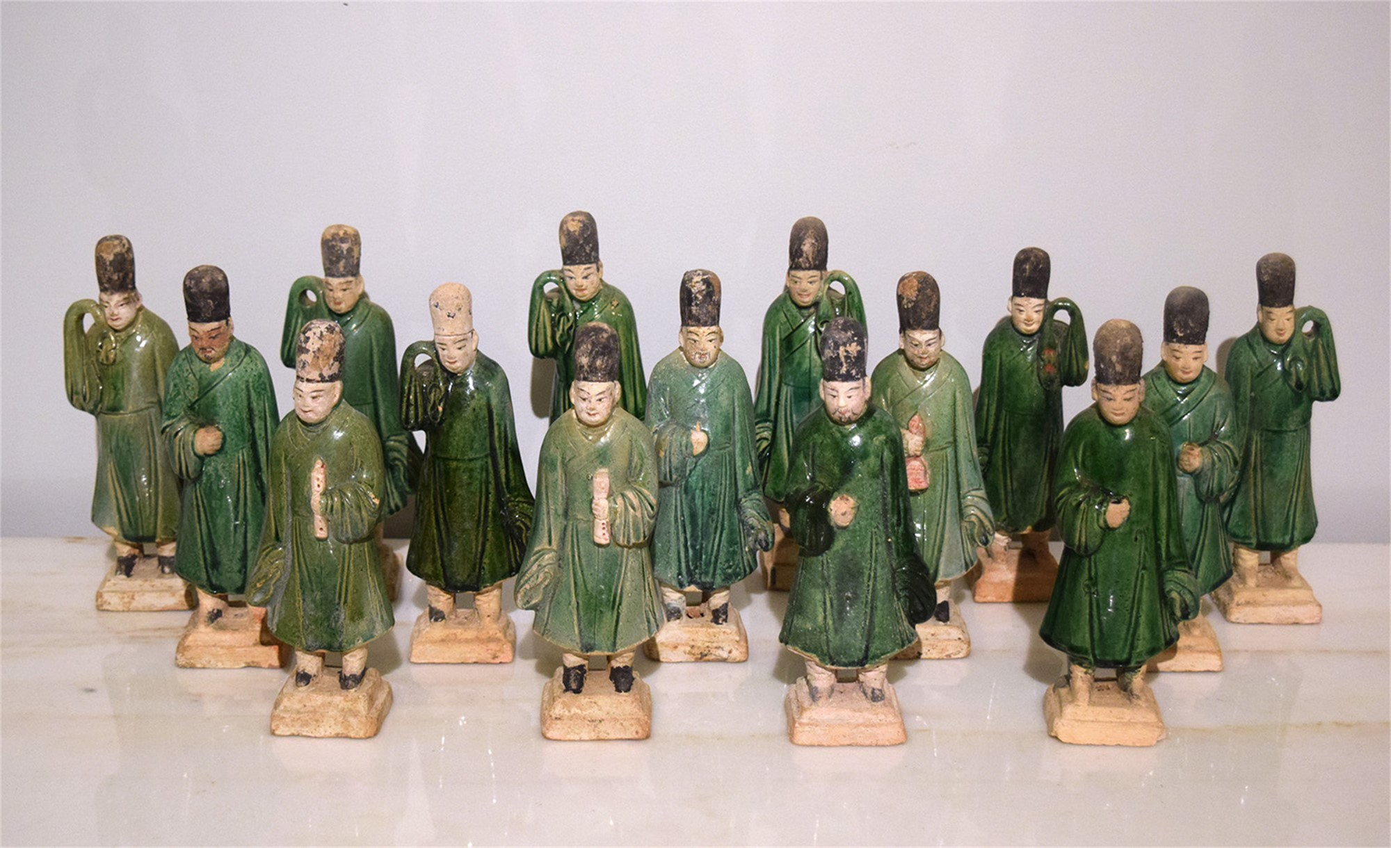 SET OF 15 GREEN-GLAZED POTTERY FIGURES