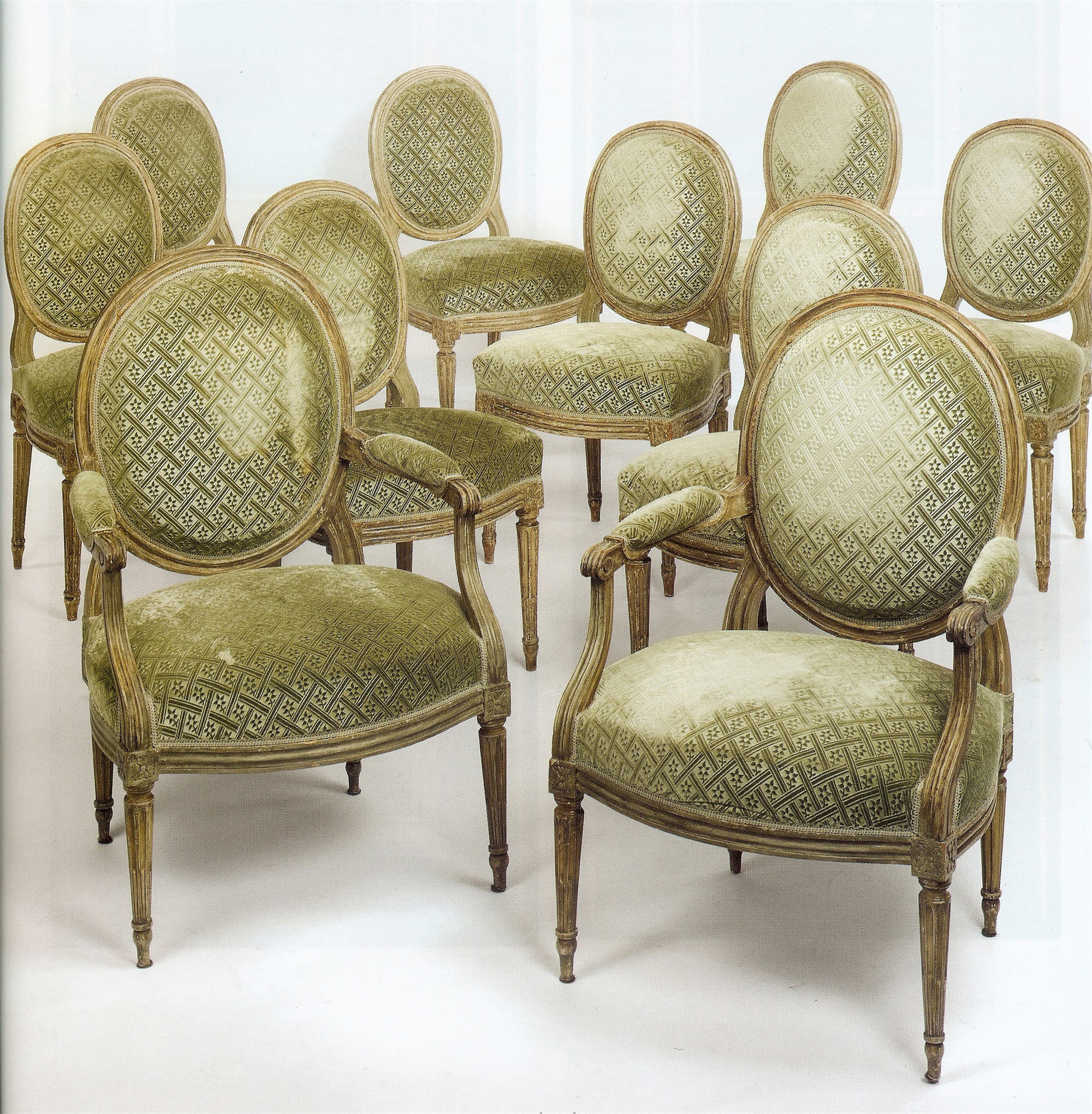 SET OF TEN LOUIS XVI PAINTED DINING CHAIRS by Jean Avisse