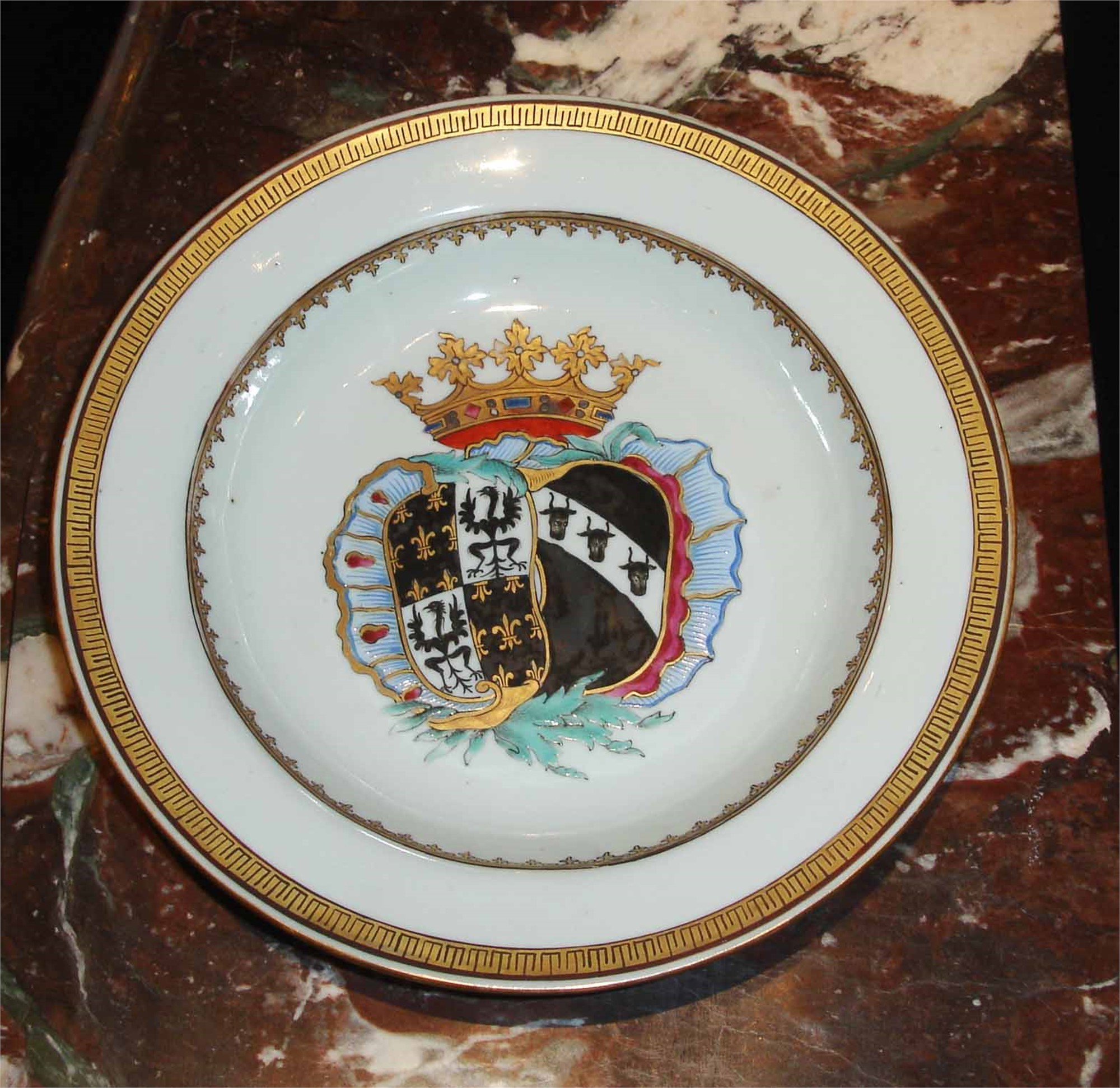 SET OF 11 ARMORIAL SOUP-PLATES FOR THE DUTCH MARKET WITH ARMS OF DE FAMARS AND VRIESEN