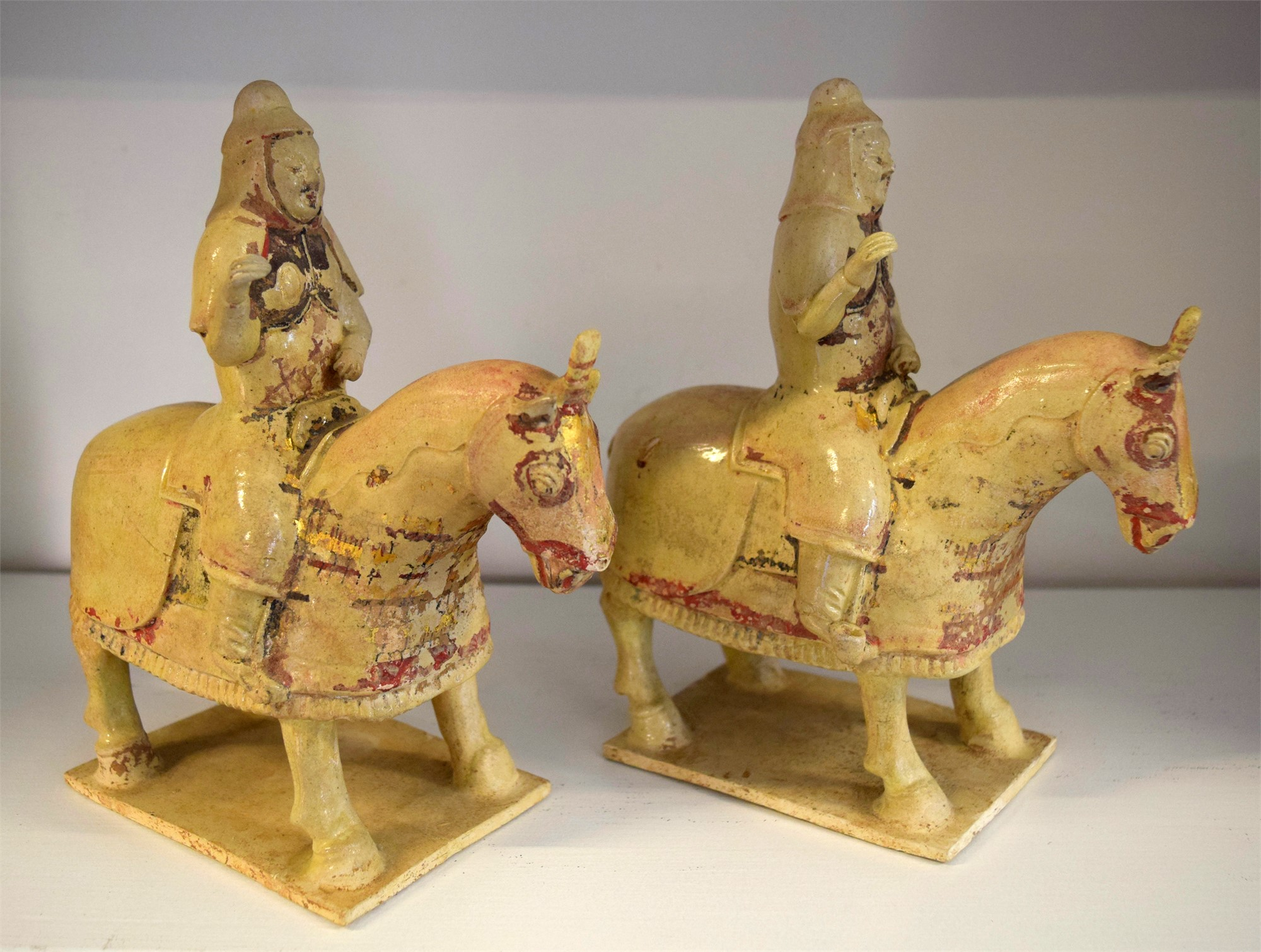 PAIR OF SMALL STRAW-GLAZED POTTERY of ARMORED EQUESTRIANS
