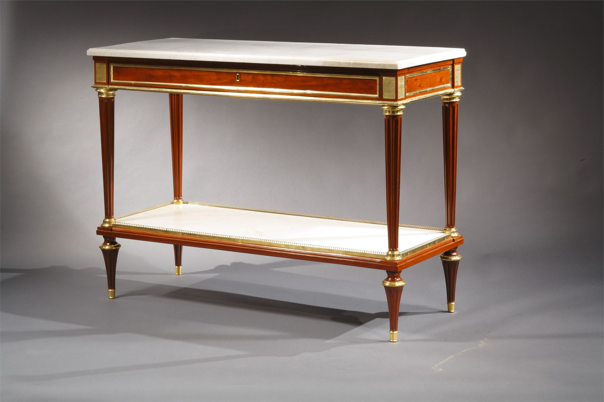 PAIR OF LOUIS XVI MAHOGANY MARBLE TOP CONSOLES ATTRIB. TO WEISWEILER by Adam Weisweiler