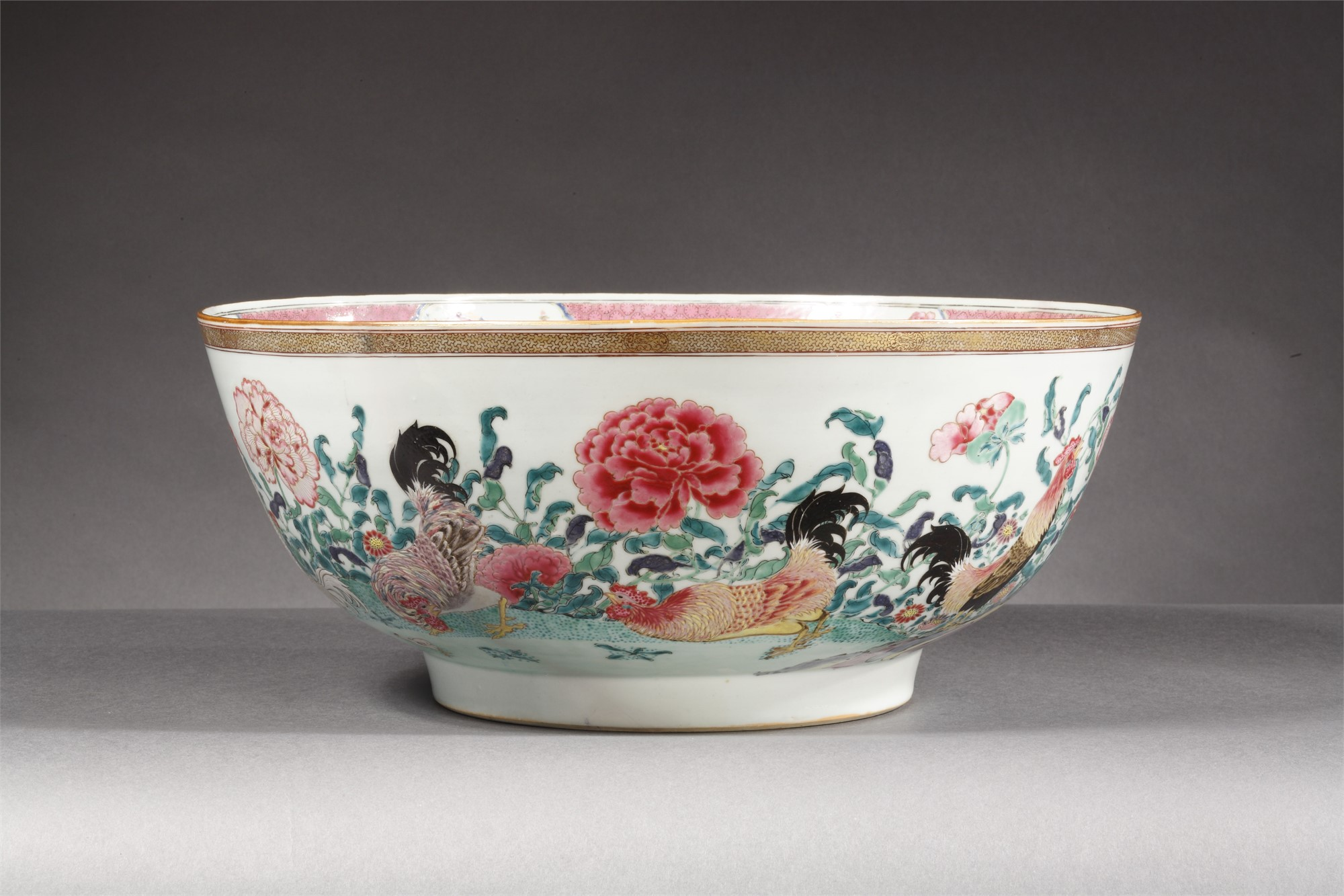 SUPERB EXPORT FAMILLE-ROSE PUNCH BOWL WITH COCKERELS AND PEONIES