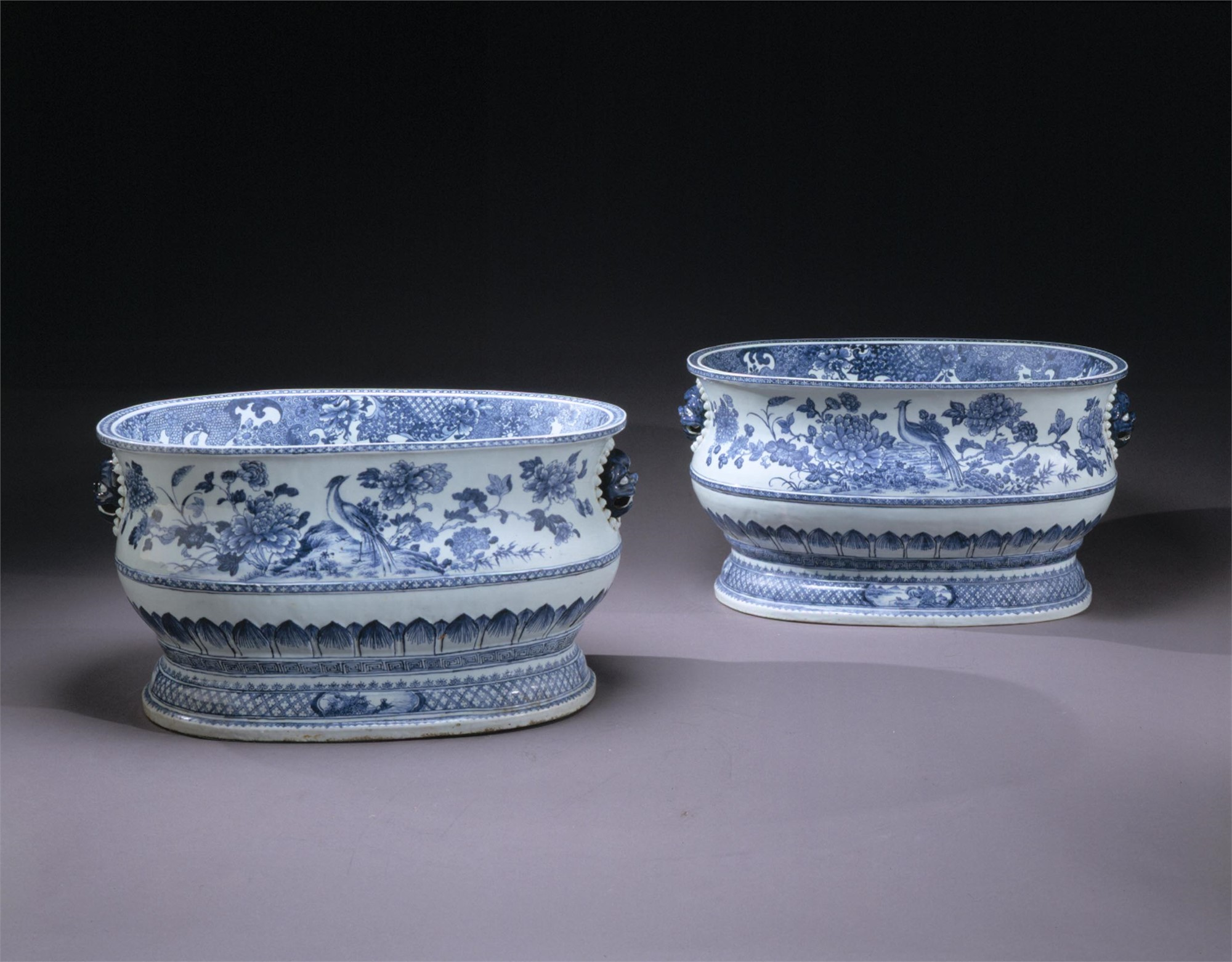 PAIR OF LARGE BLUE AND WHITE CISTERNS