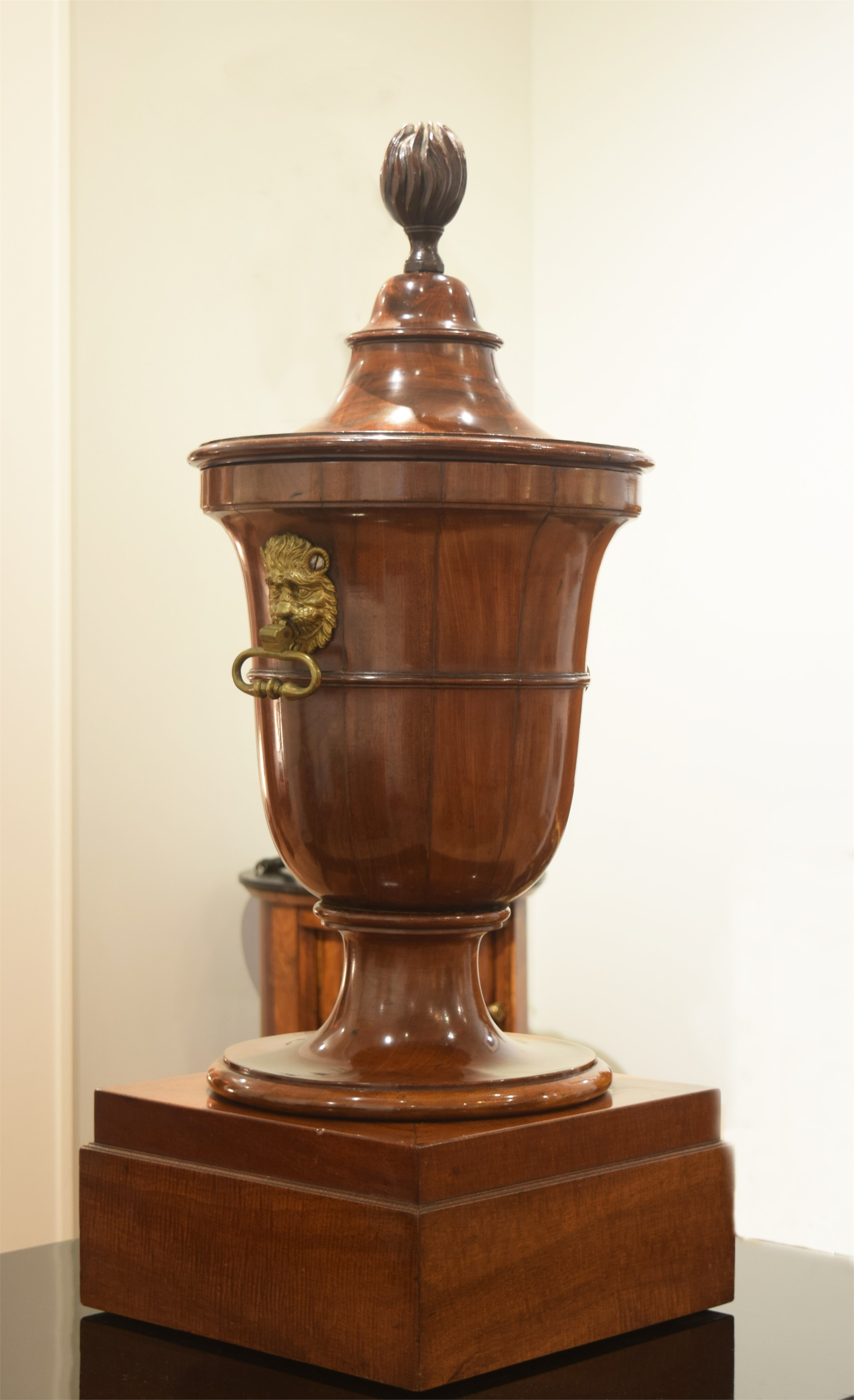 GEORGE III BRASS-MOUNTED CARVED MAHOGANY URN-FORM CELLARETTE
