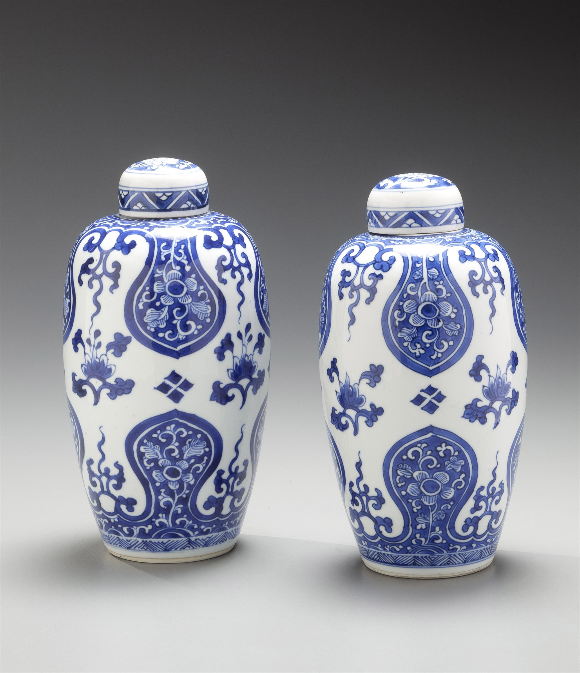 PAIR OF BLUE AND WHITE OVOID JARS AND COVERS