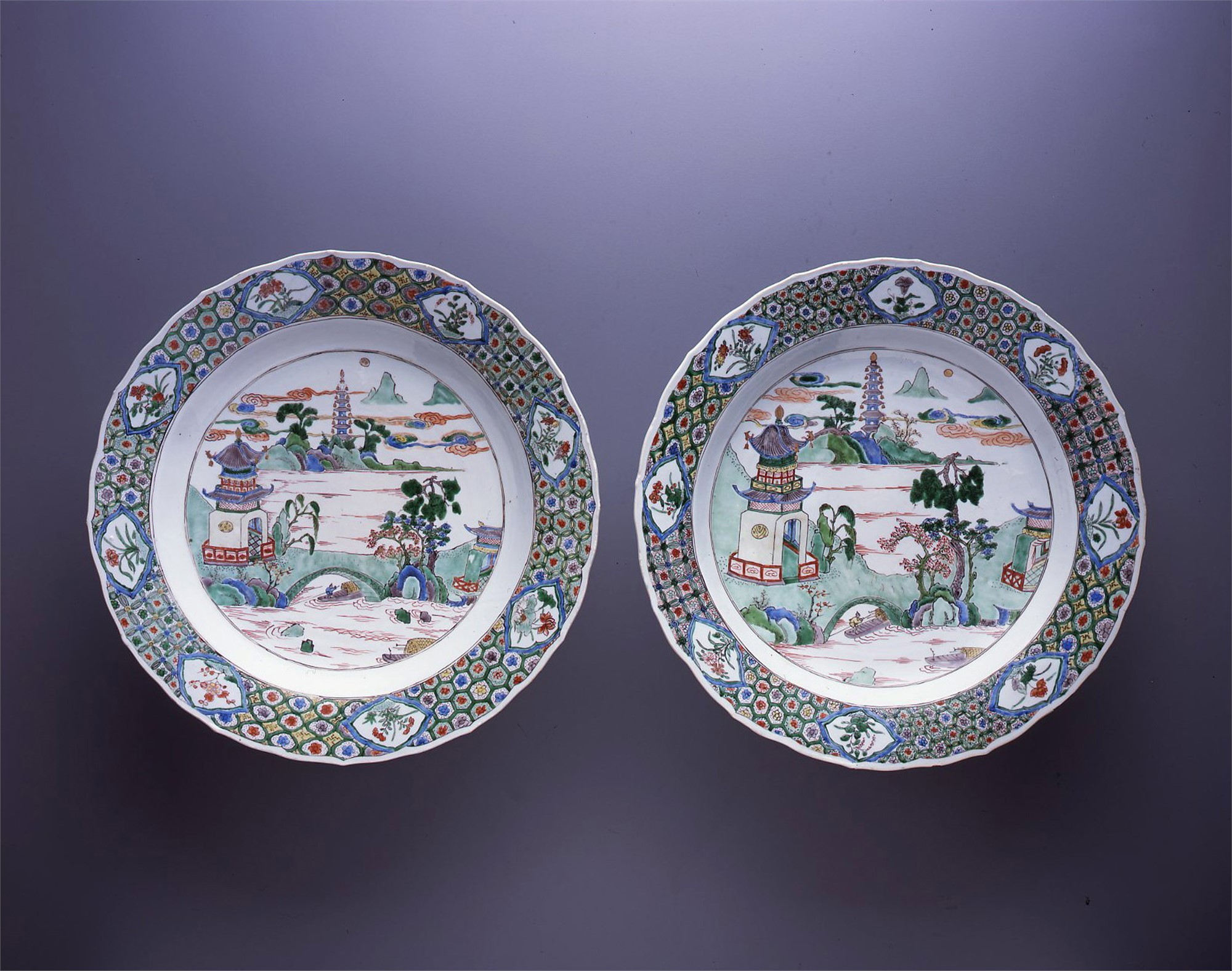 PAIR OF FAMILLE VERTE DISHES WITH RIVER LANDSCAPES