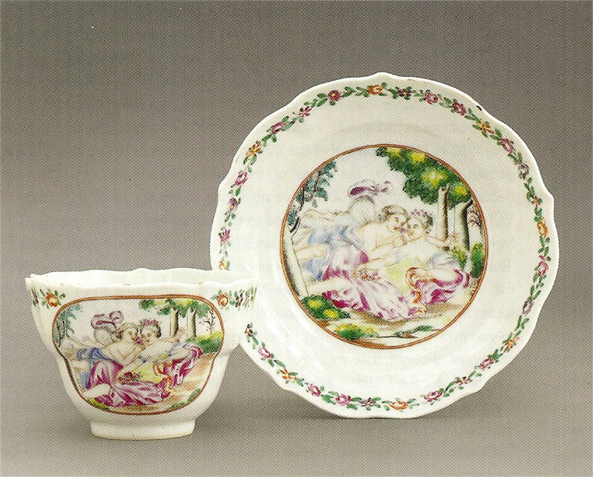 LARGE FAMILLE ROSE TEACUP AND SAUCER WITH CUPID AN PSYCHE